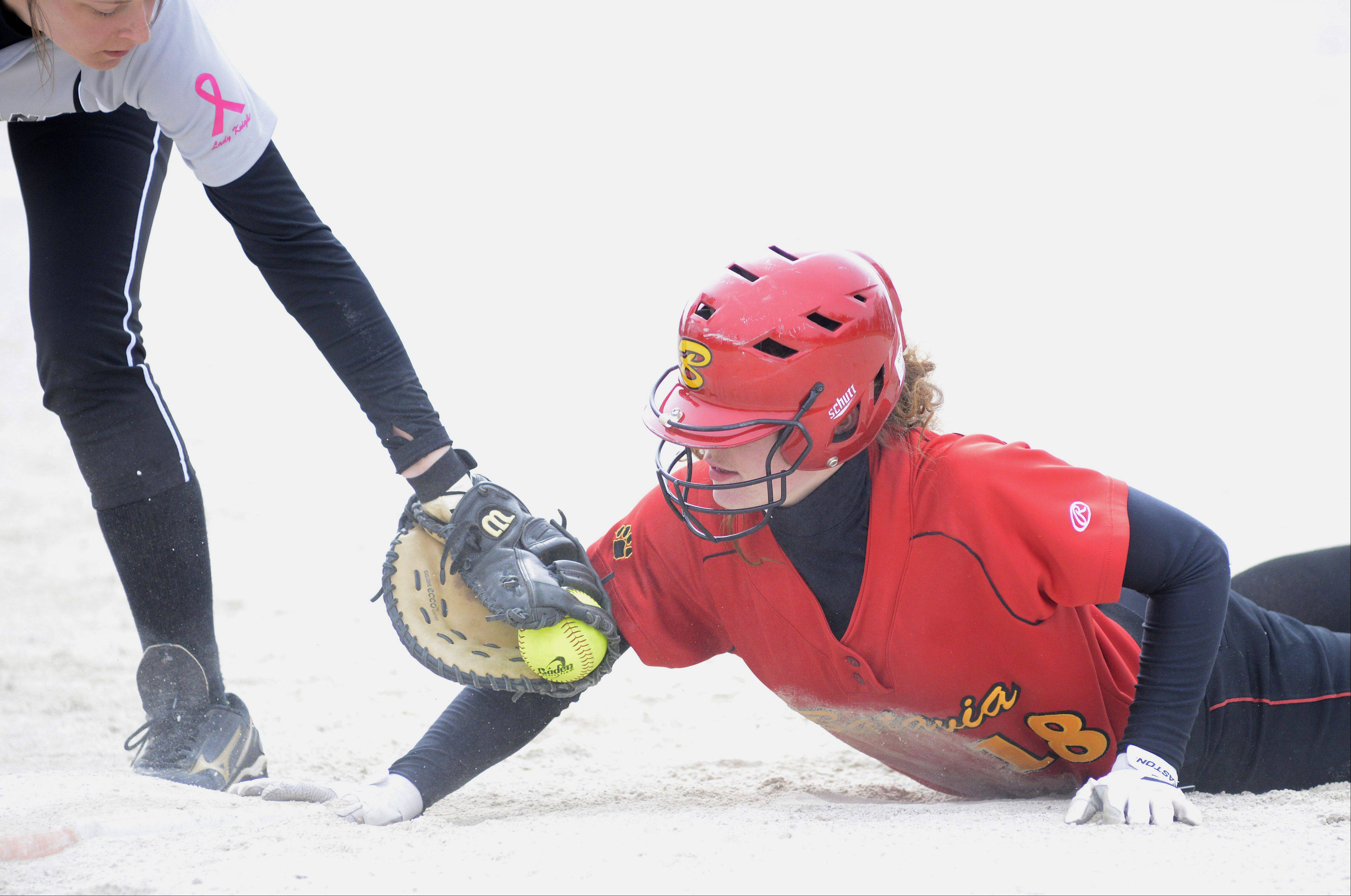 Batavia's Katie Ryan is safe back at first base from Kaneland's Hayley Contorno in the first inning on Saturday, April 6.