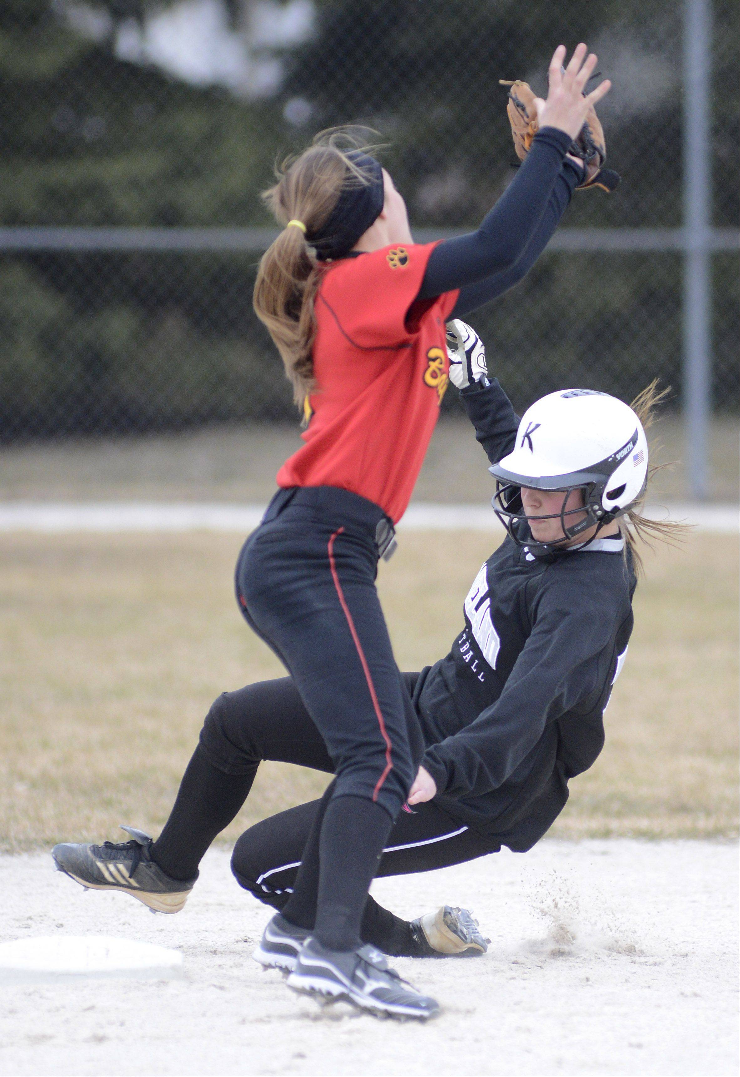 Kaneland's Lexi Roach is tagged out by Batavia's Alex Scaccia as she slides into second base in the first inning on Saturday, April 6.