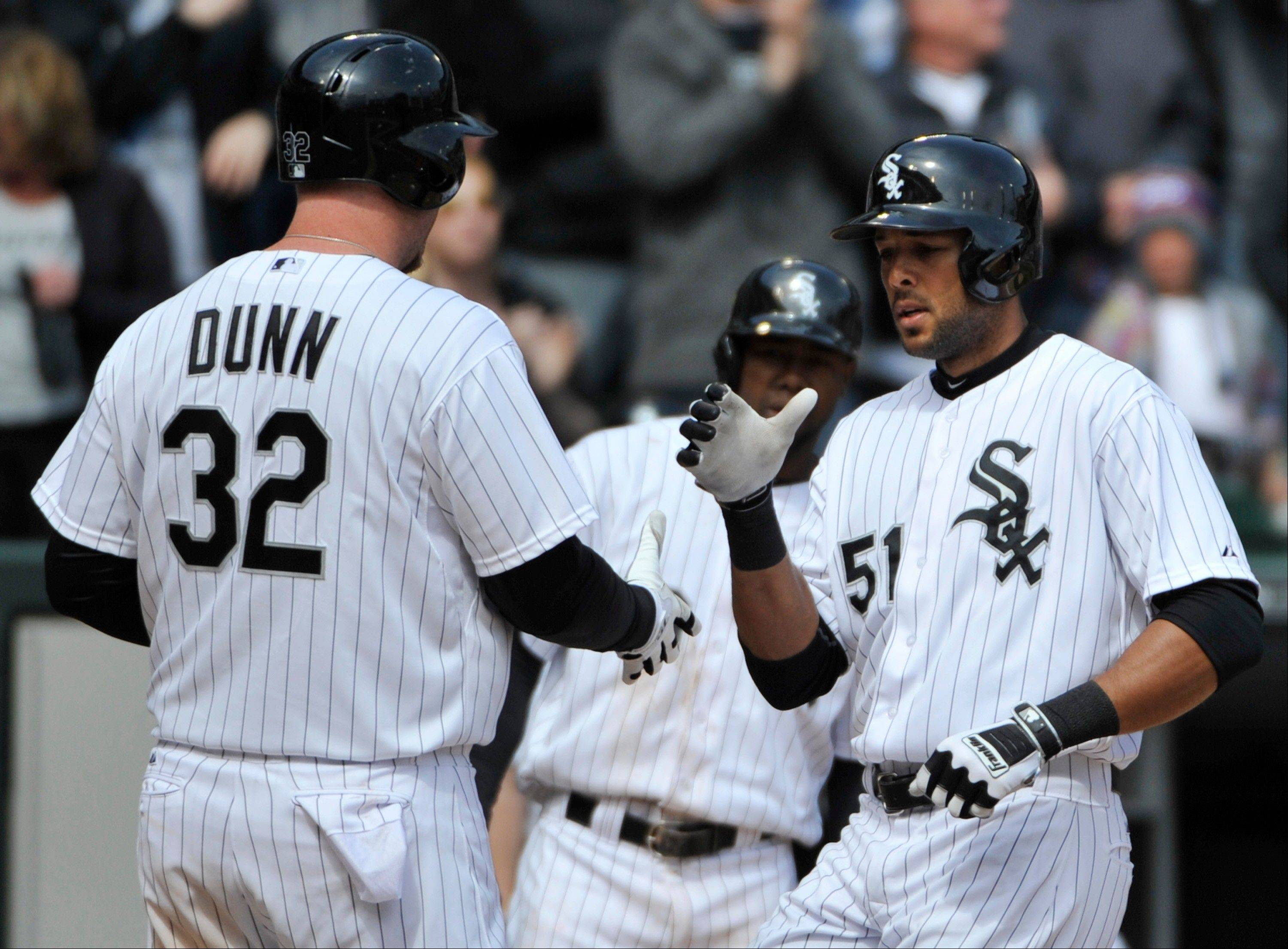 Chicago White Sox's Alex Rios, right, is greeted by Adam Dunn after hitting a two-run home run in the sixth inning of a baseball game against the Seattle Mariners, Saturday, April 6, 2013 in Chicago.