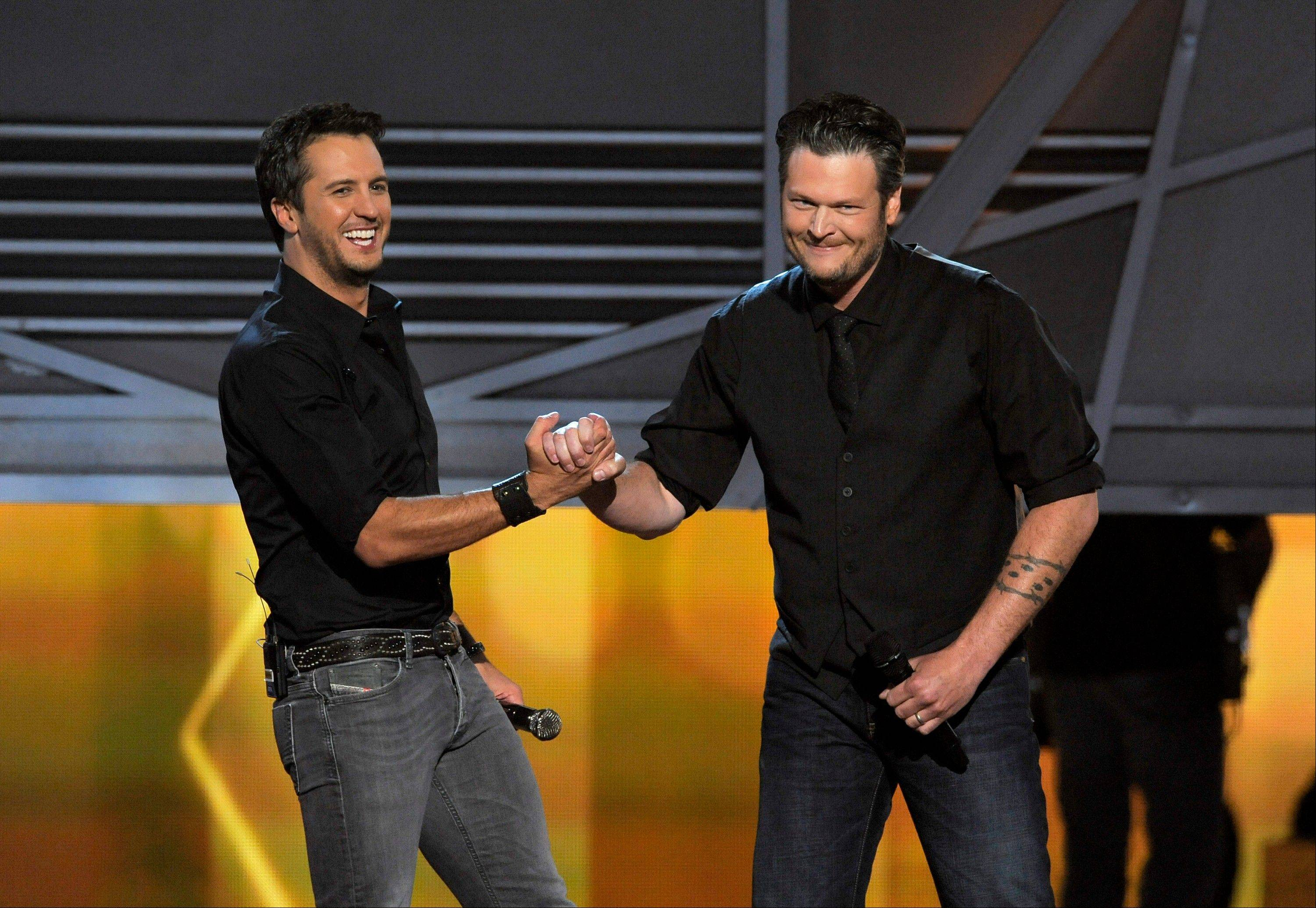 Luke Bryan, left, and Blake Shelton have a little fun while co-hosting the 48th Annual Academy of Country Music Awards Sunday at the MGM Grand Garden Arena in Las Vegas. Bryan was named entertainer of the year.