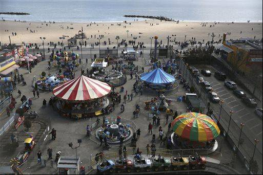 The beach and visitors to Deno's Famous Wonder Wheel Amusement Park in New York's Coney Island are seen from the park's famous ride. Many of the seasonal businesses at Coney Island are still reeling from the aftermath of Superstorm Sandy.