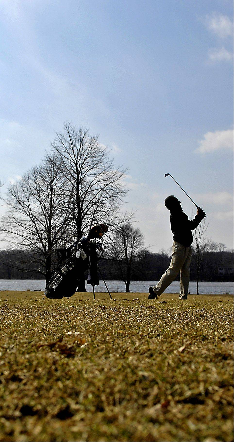 Brian Charles of St. Charles hits the links at Pottawatomie Park Golf Course in St. Charles as they open for the first time this season. Charles won the St. Charles city championship last year and was eager to get back out today when he saw the temperature this morning.