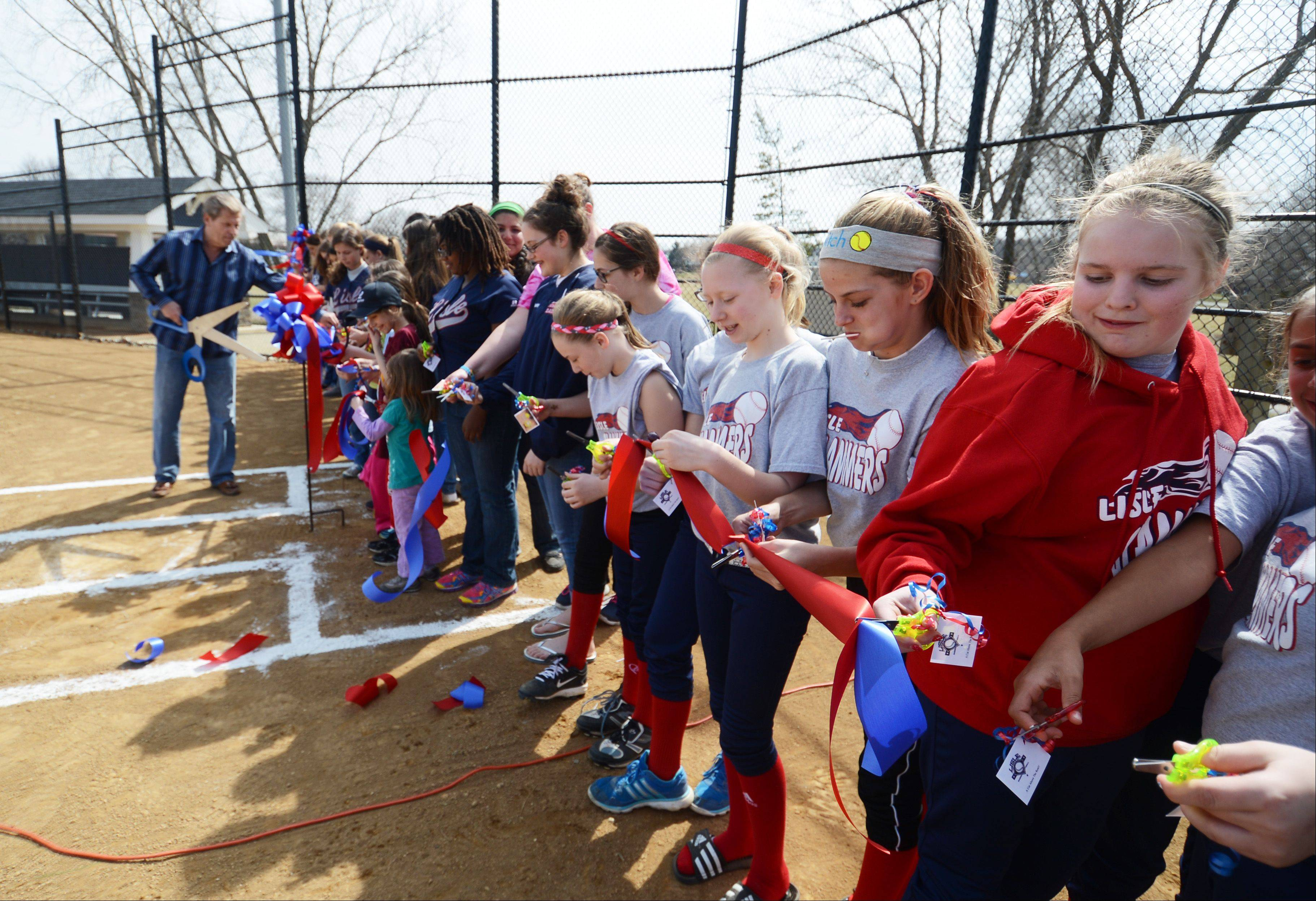 The Lisle Baseball Softball League dedicates their C5 softball field with a ribbon cutting Sunday in Community Park.