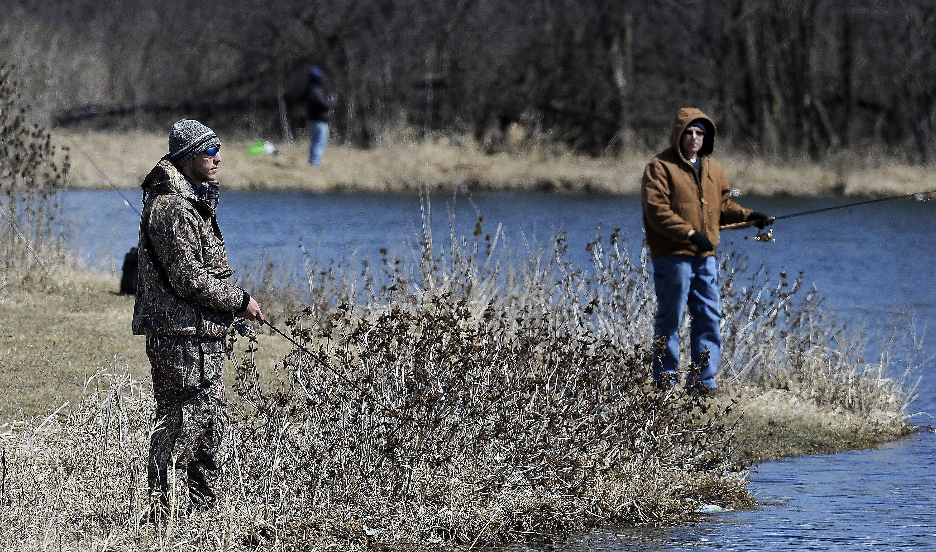 Frank Ryan and his dad Don, both of Schaumburg, didn't feel like taking in the Sox's home opener on Monday, so the next best thing is fishing at Busse Woods in a 28 degree wind chill.