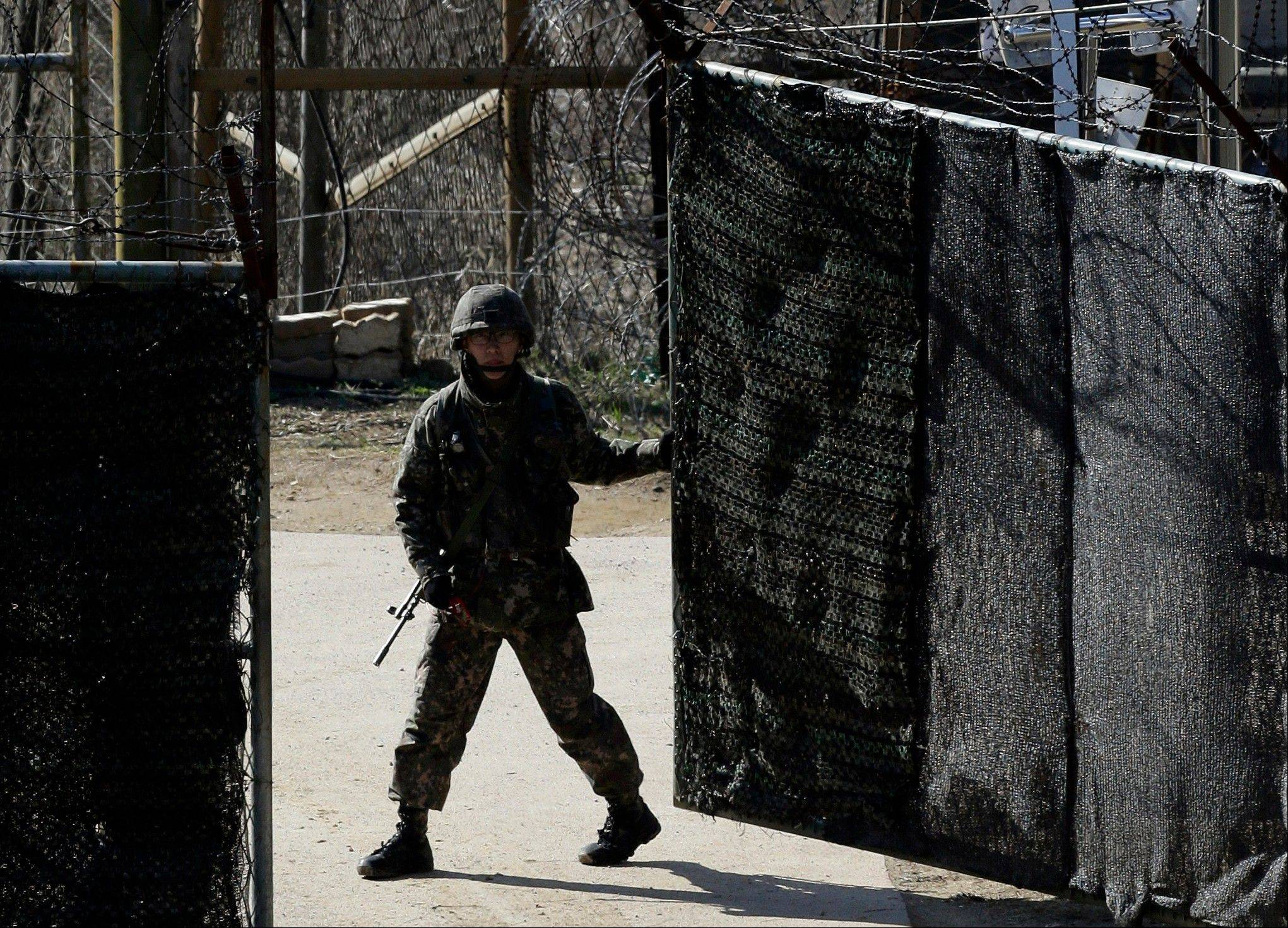 A South Korean soldier closes a military gate in Paju, north of Seoul, South Korea, Sunday