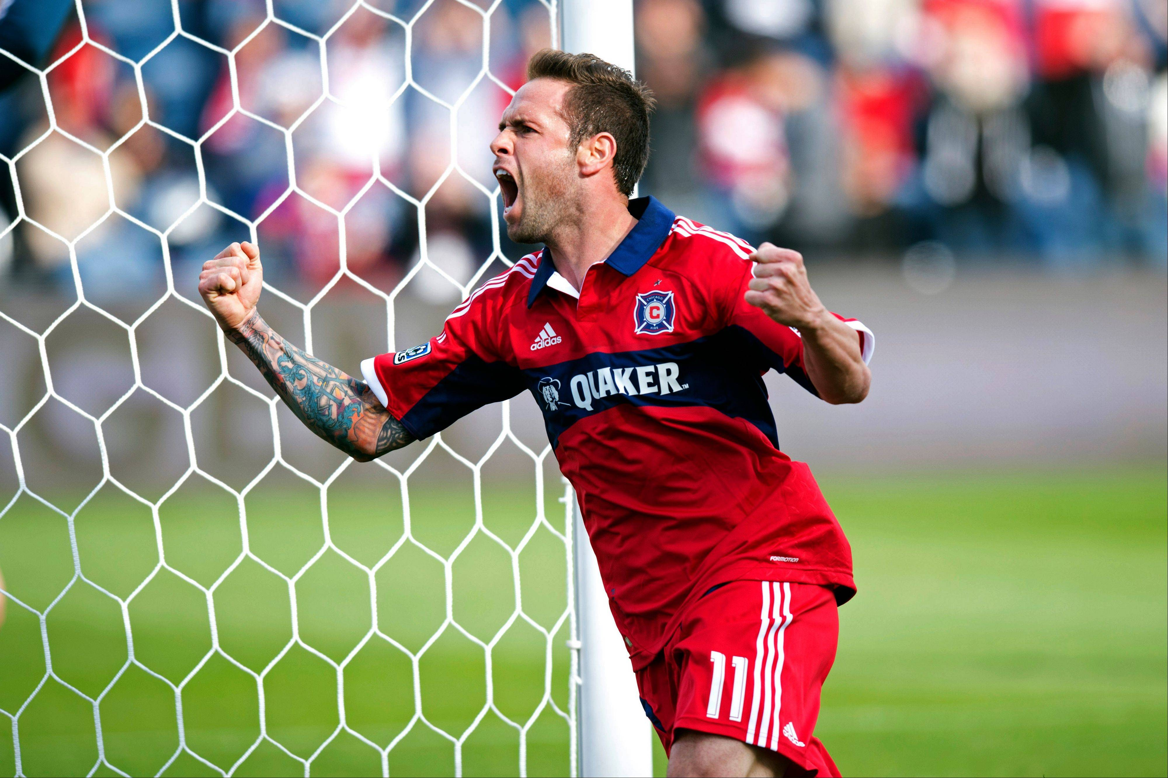 In this photo provided by the Chicago Fire, Chicago Fire forward Daniel Paladini celebrates his goal against the New York Red Bulls during the first half of an MLS soccer match, Sunday, April 7, 2013, in Bridgeview, Ill. The Fire won 3-1.