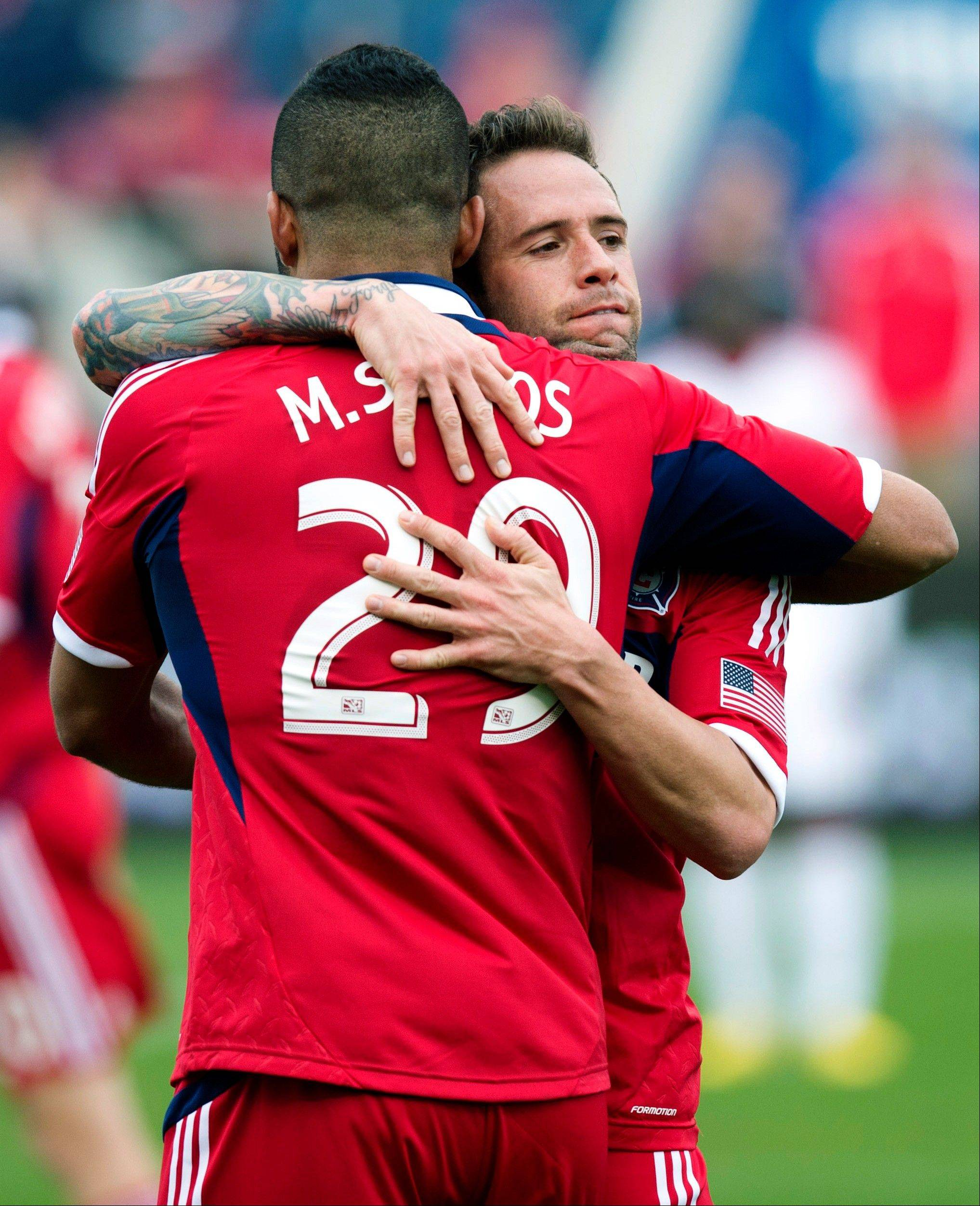 In this photo provided by the Chicago Fire, Chicago Fire's Daniel Paladini, right, hugs Maicon Santos after Santo's second goal against the New York Red Bulls during the second half of an MLS soccer match, Sunday, April 7, 2013, in Bridgeview, Ill. The Fire won 3-1.