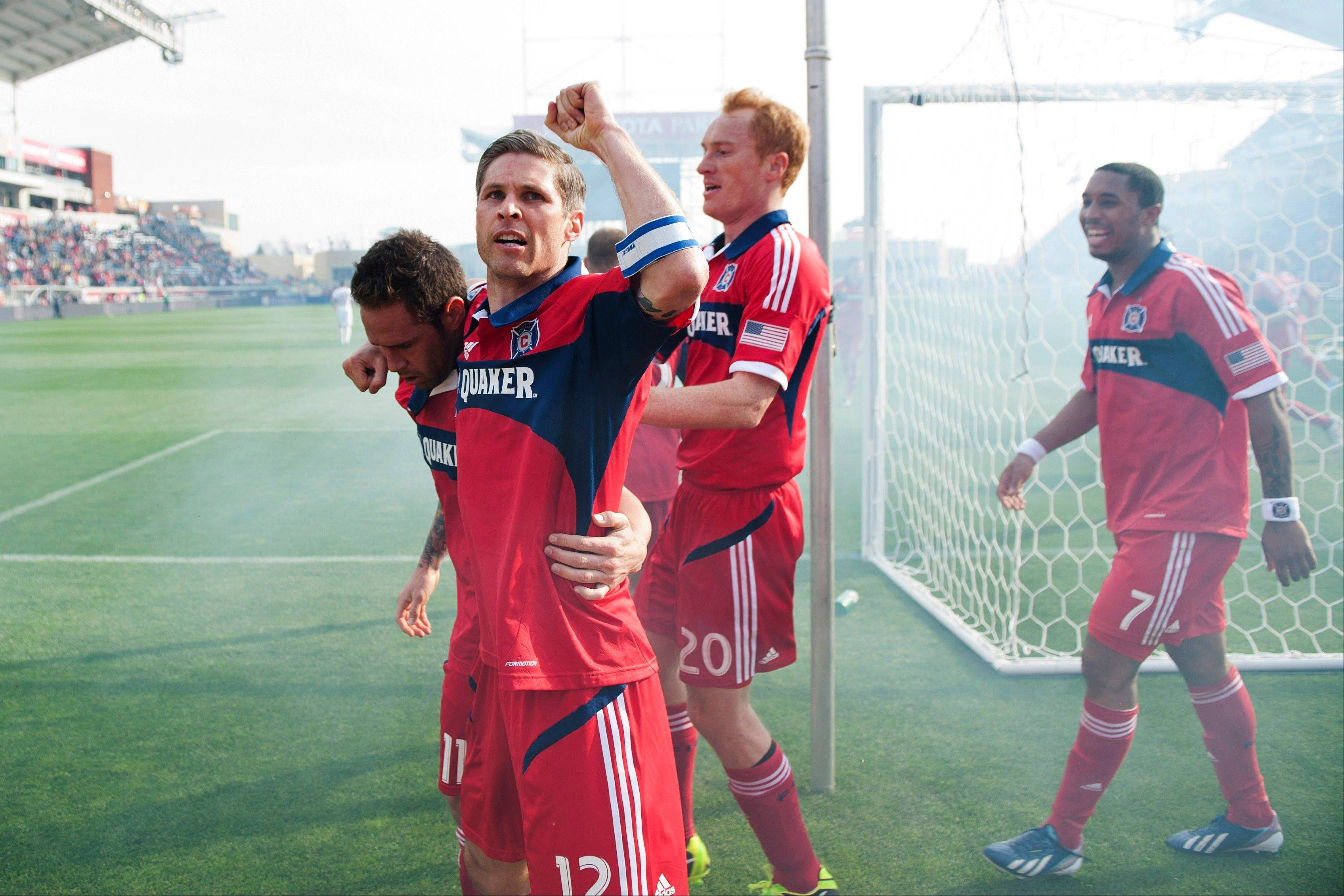 In this photo provided by the Chicago Fire, from left, Chicago Fire's Daniel Paladini, Logan Pause, Jeff Larentowicz and Sherjill MacDonald celebrate Paladini's goal against the New York Red Bulls during the first half of an MLS soccer match, Sunday, April 7, 2013, in Bridgeview, Ill. The Fire won 3-1.