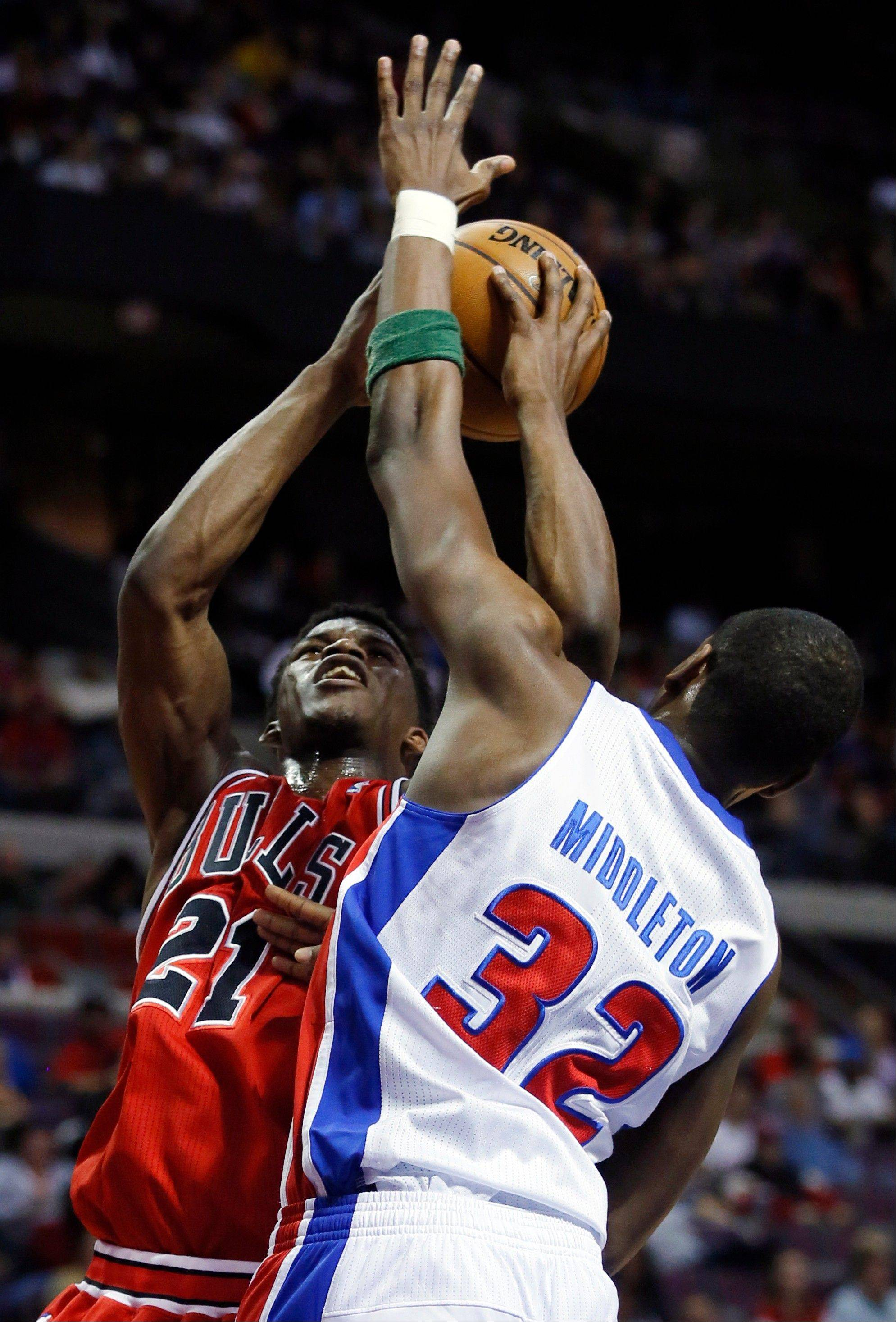 Bulls guard Jimmy Butler shoots against Pistons forward Khris Middleton on Sunday night.