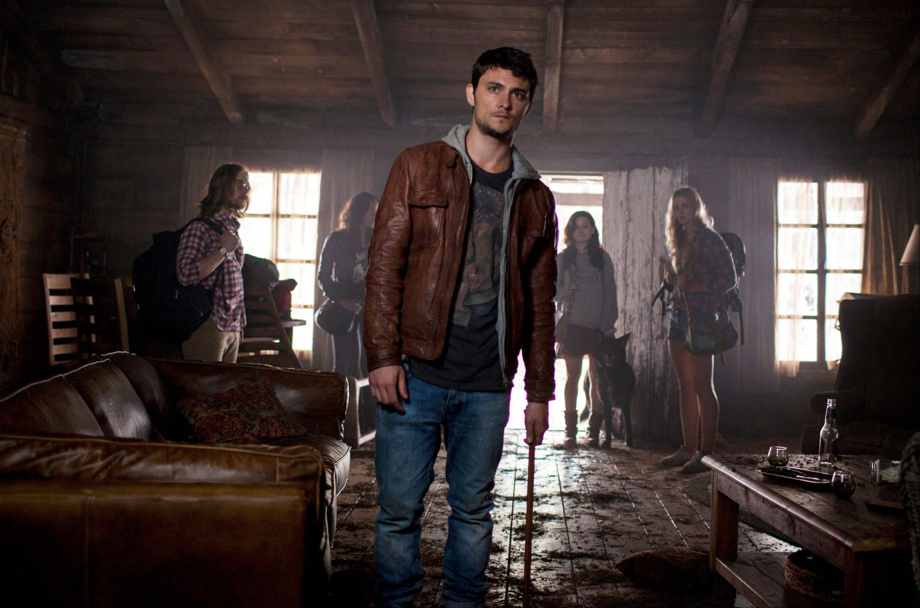 Shiloh Fernandez, center, stars in �Evil Dead.�