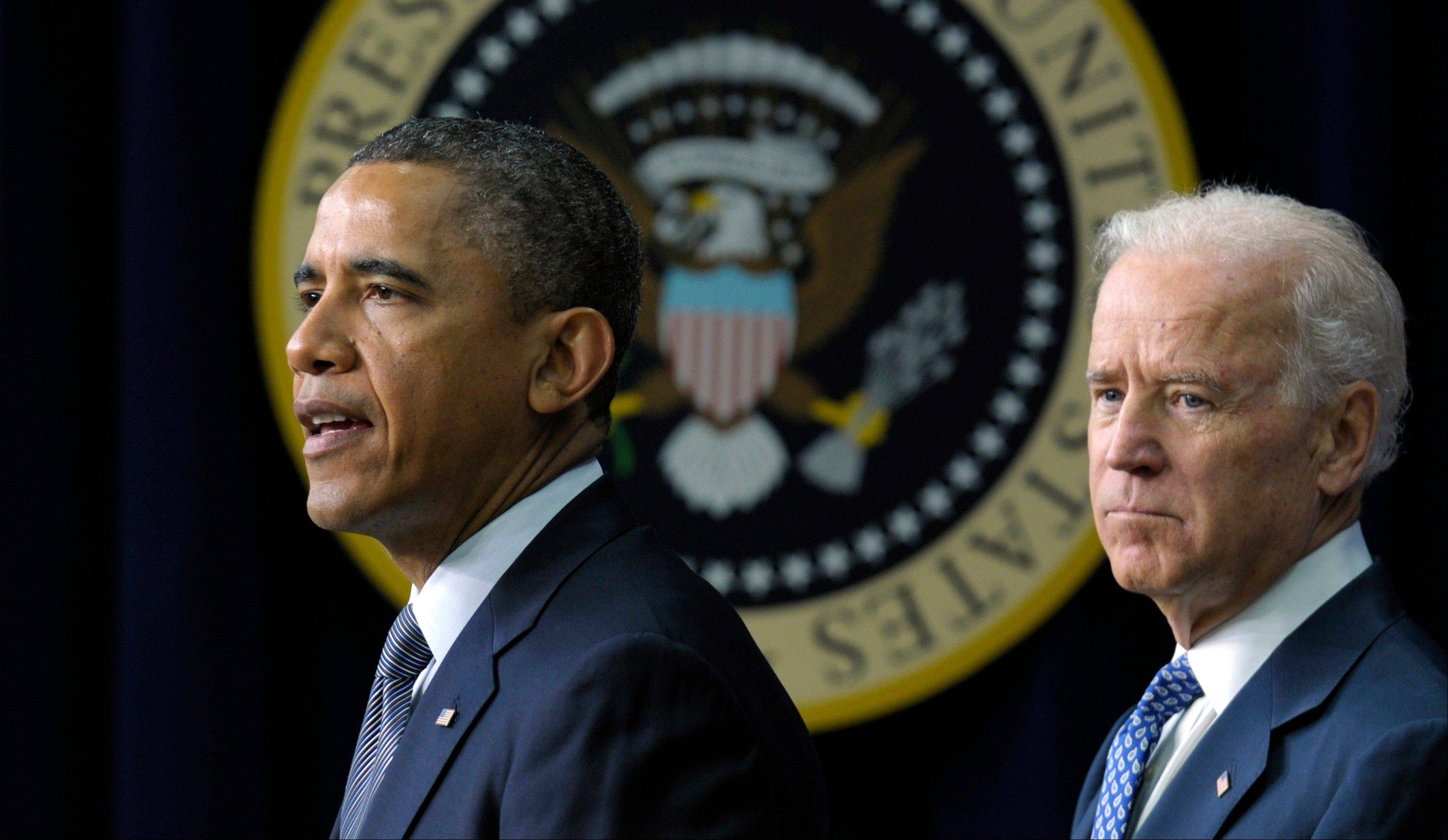 In this Jan. 16 file photo, President Barack Obama, accompanied by Vice President Joe Biden, discusses proposals to reduce gun violence, at the White House. Obama is bringing 11 relatives of those killed in the shooting at Connecticut�s Sandy Hook Elementary School to Washington on Air Force One Monday so they can personally encourage senators to back gun legislation that faces tough opposition.
