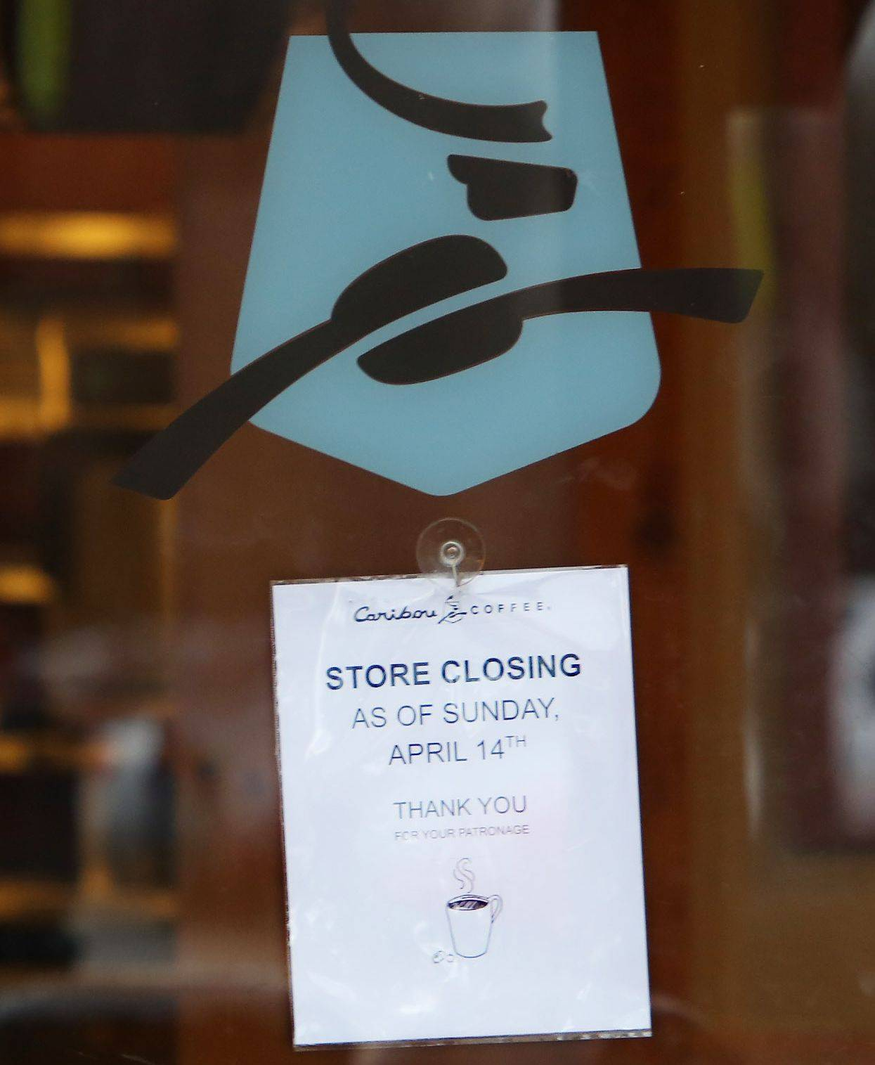 A sign notifies customers that the Caribou Coffee in Libertyville will close for good on Sunday.