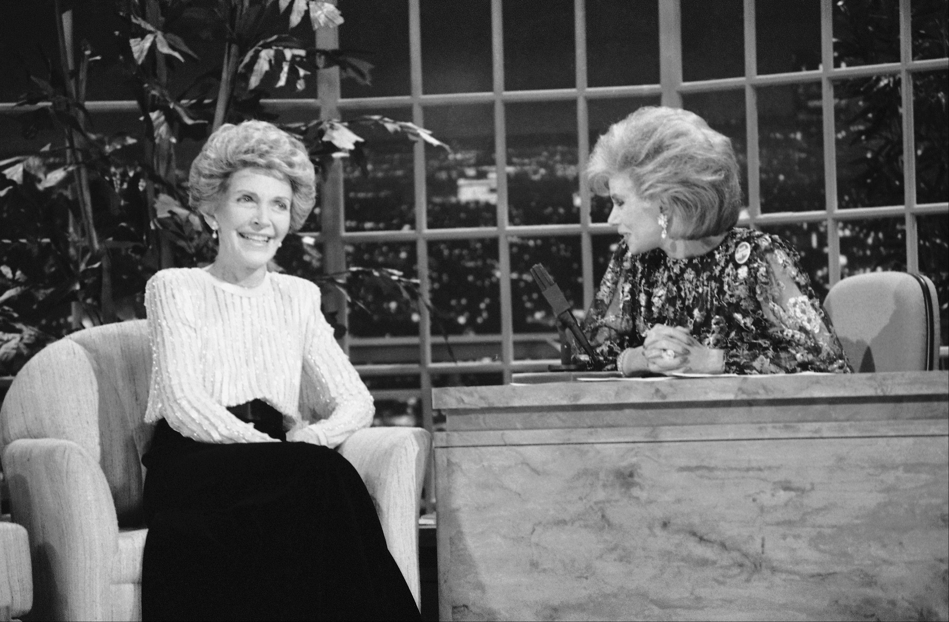 "FILE -- In this Oct. 30, 1986 file photo, Talk show host Joan Rivers, right, talks with guest, first lady Nancy Reagan, during her appearance on ""The Late Show Starring Joan Rivers,"" on Fox TV in 1986."
