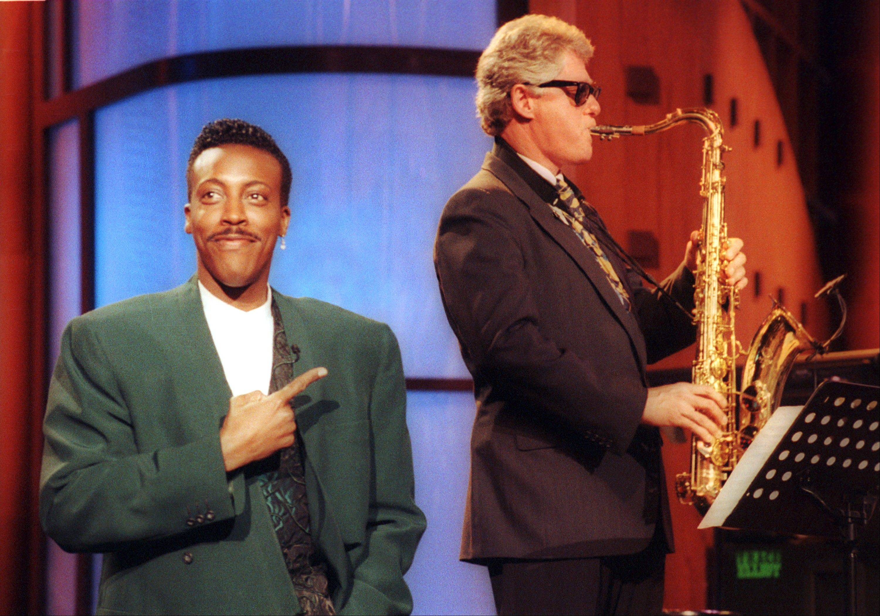 "Arkansas Gov. Bill Clinton, right, plays the saxophone with the band during the musical opening of ""The Arsenio Hall Show, "" in the Hollywood section of Los Angeles in 1992. The role of female talk-show hosts in late-night TV network history, all 50-plus years of it, can be summed up in two words: Joan Rivers. It takes just another two _ Arsenio Hall _ to do the same for minorities. There's no indication that minorities will be hosting talk shows in the latest round of musical chairs involving ""Tonight"" and ""Late Night."""