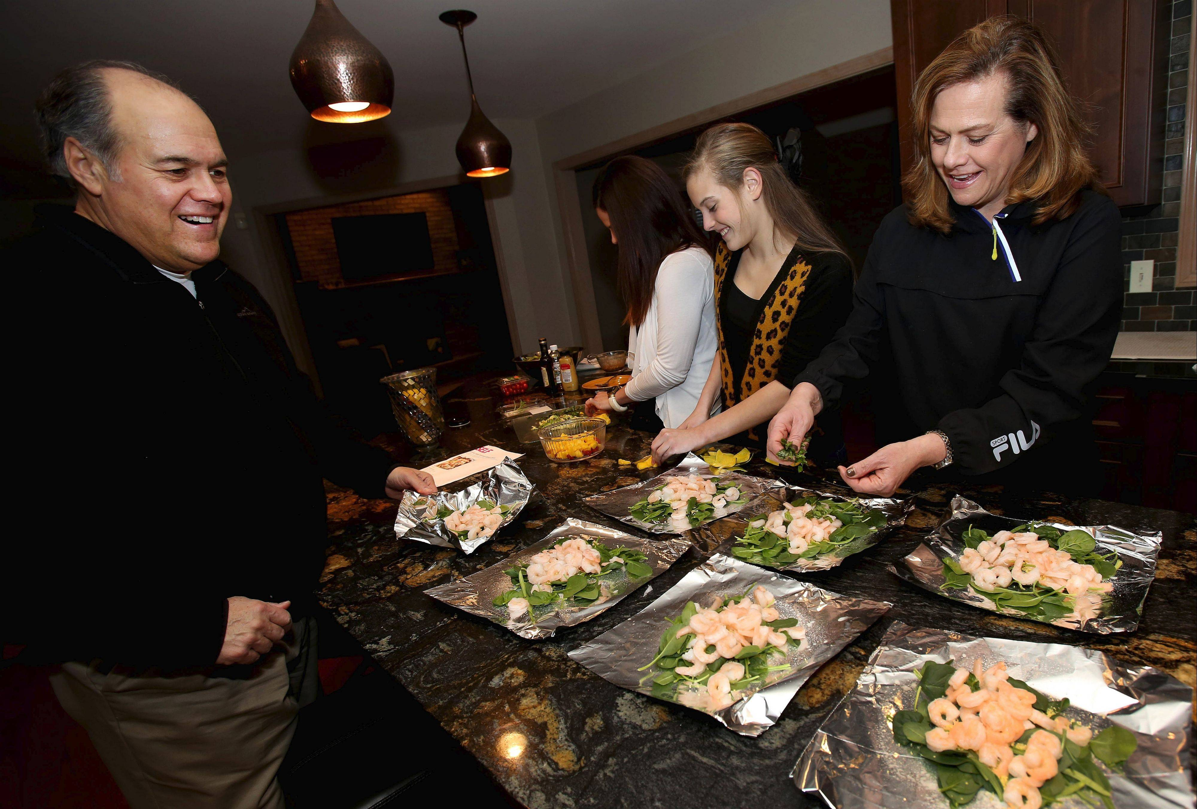 Preparing healthy meals is a family affair for Mike Paulos.