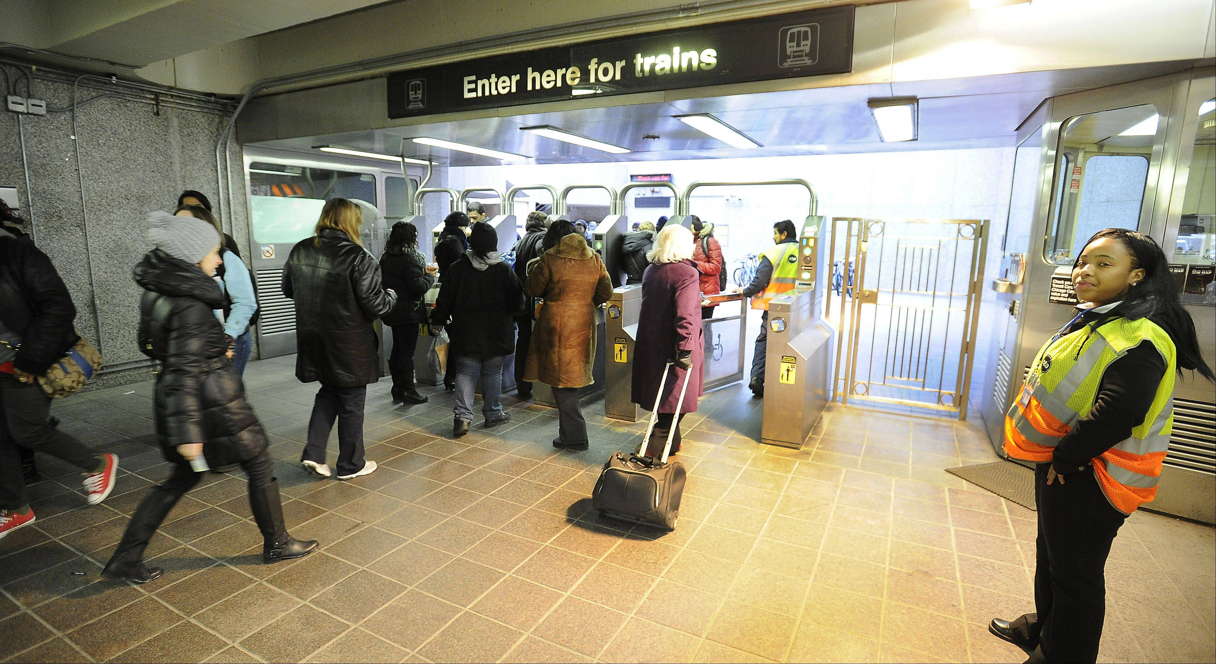 Commuters head to Pace buses after getting off the Blue Line train at the Rosemont station. Suburban commuters who use PACE and CTA patrons soon will have access to the transit agencies universal fare card, known as Ventra.