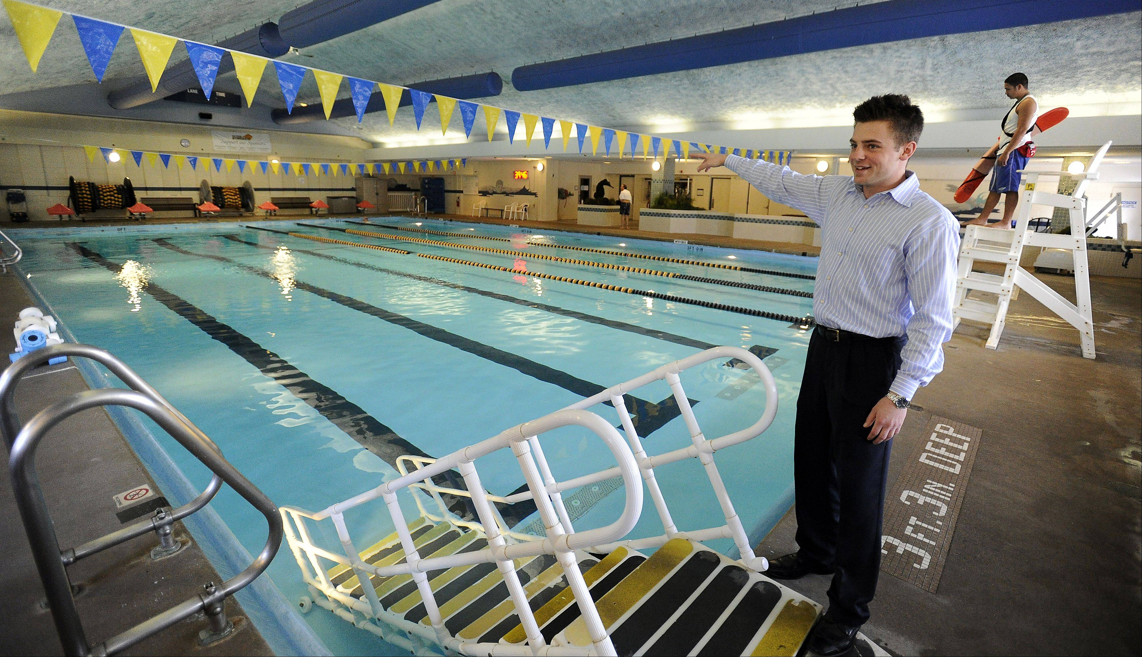 Jason Dale, an employee of the Elk Grove Park District Pavilion Aquatic Center, points out how the 25-yard indoor pool will be expanded starting next week. The entire renovation will last at least a year, officials said.