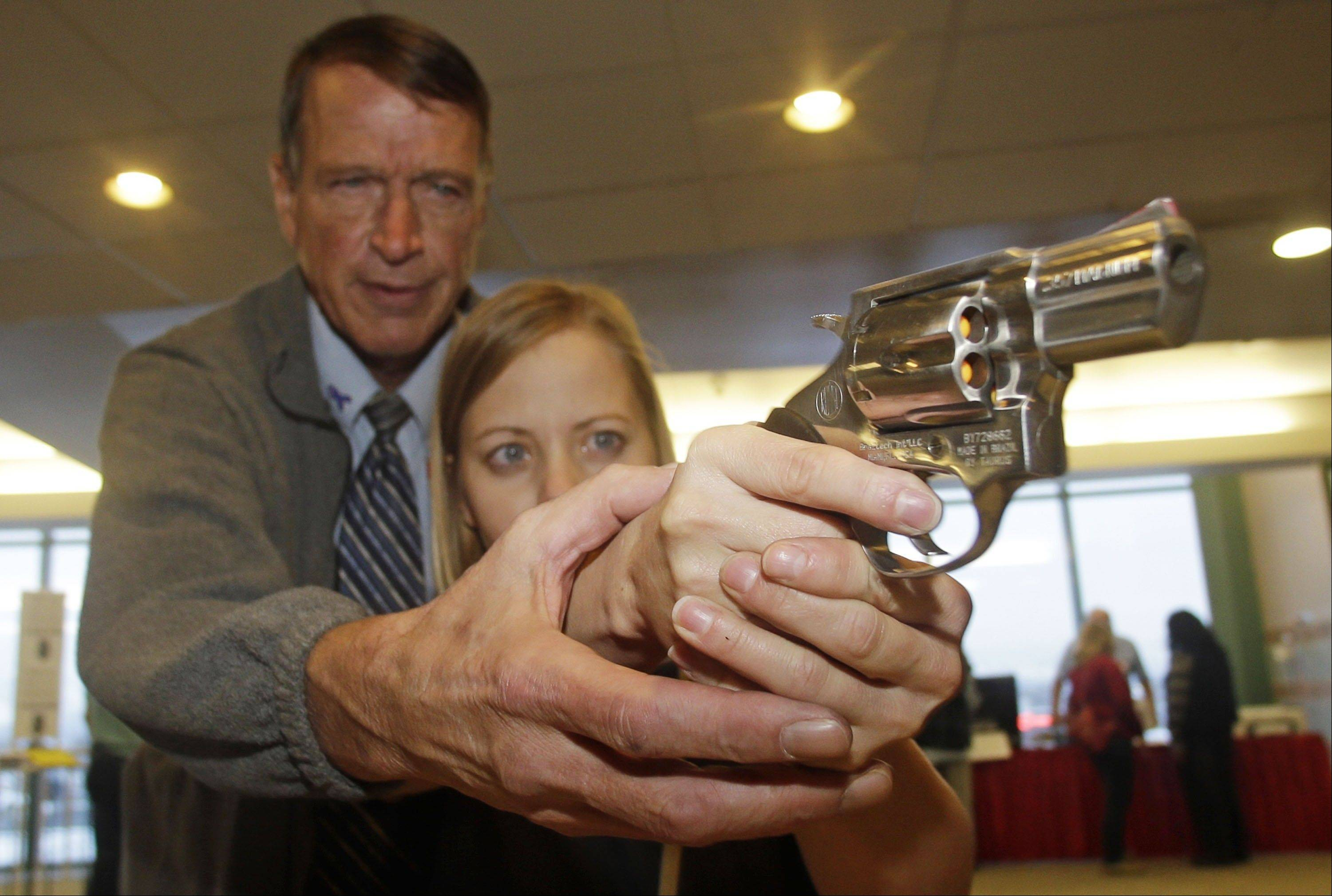 Cori Sorensen, a fourth grade teacher from Highland Elementary School in Highland, Utah, receives firearms training with a .357 magnum from personal defense instructor Jim McCarthy in West Valley City, Utah, where teachers and administrators are allowed to bring guns to school.