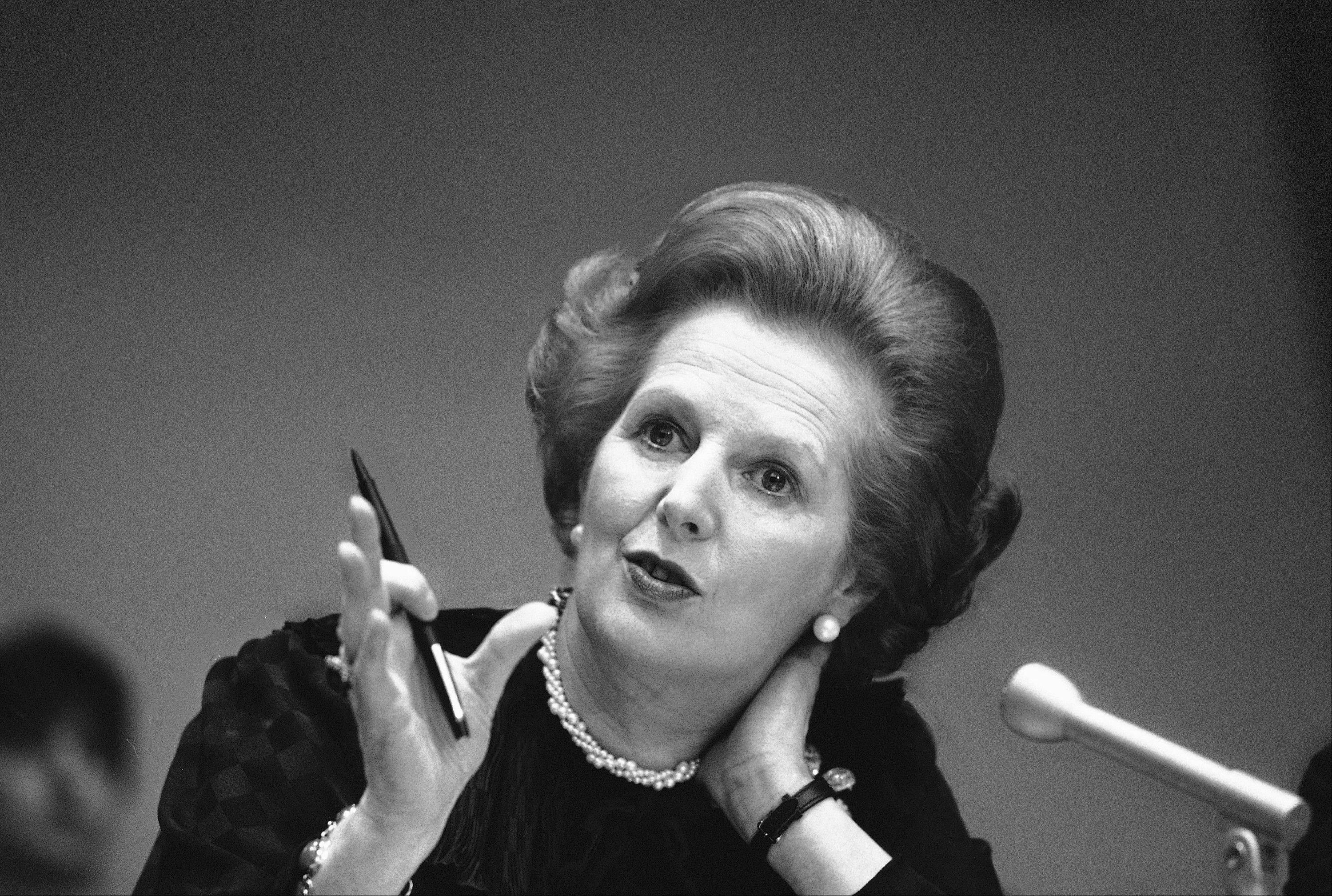 "In this June 23, 1982 file photo, Britain's Prime Minister Margaret Thatcher gestures with her pen as she answers a reporters question during a news conference at the United Nations. Ex-spokesman Tim Bell says that Thatcher has died. She was 87. Bell said the woman known to friends and foes as ""the Iron Lady"" passed away Monday morning, April 8, 2013."