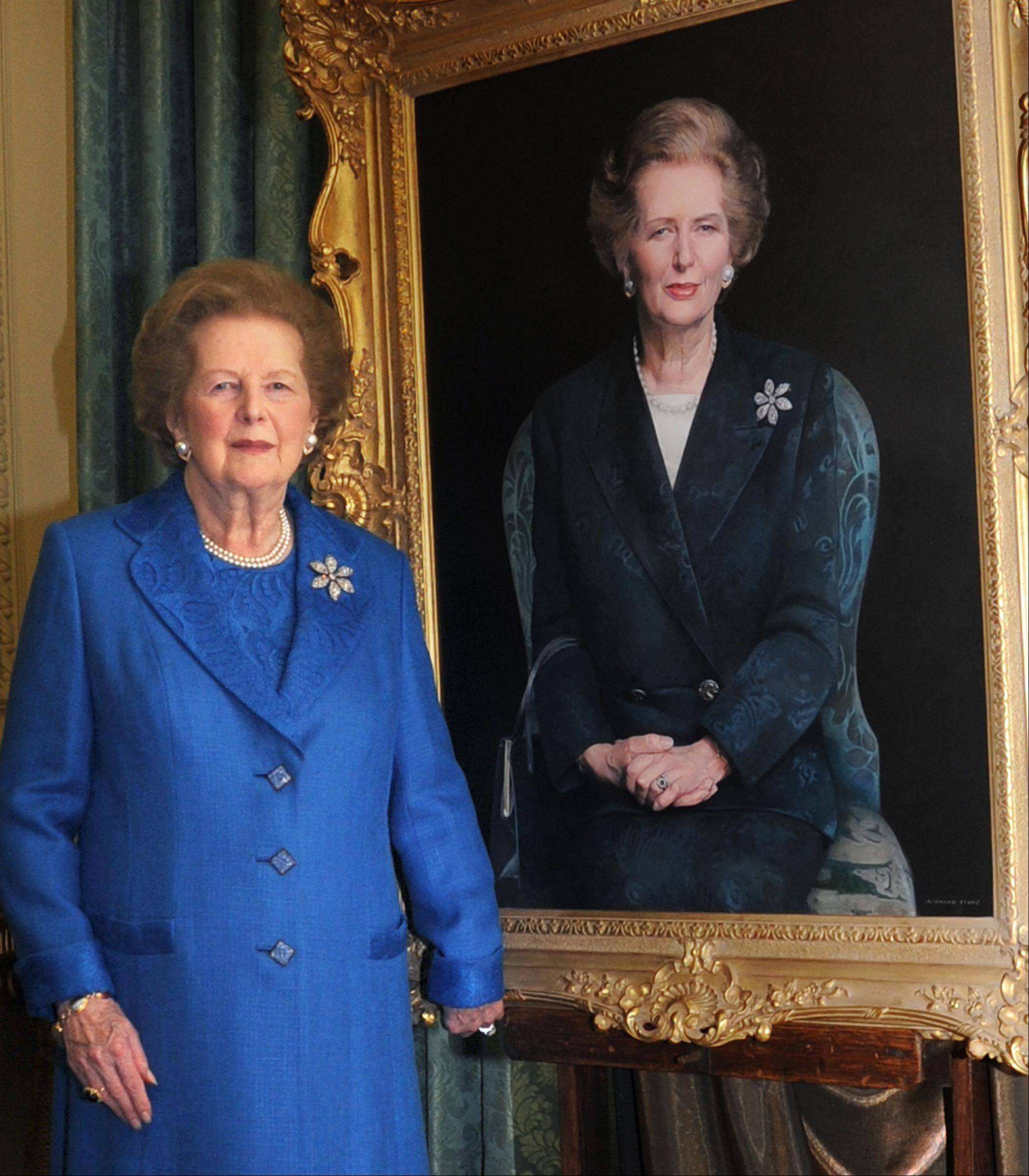 In a file handout image provided by 10 Downing Street, on Monday Nov. 23, 2009, former Prime Minister Margaret Thatcher, stands next to her portrait painted by artist Richard Stone, at 10 Downing Street in London. Thatchers former spokesman, Tim Bell, said that the former British Prime Minister Margaret Thatcher died Monday morning, April 8, 2013, of a stroke. She was 87.
