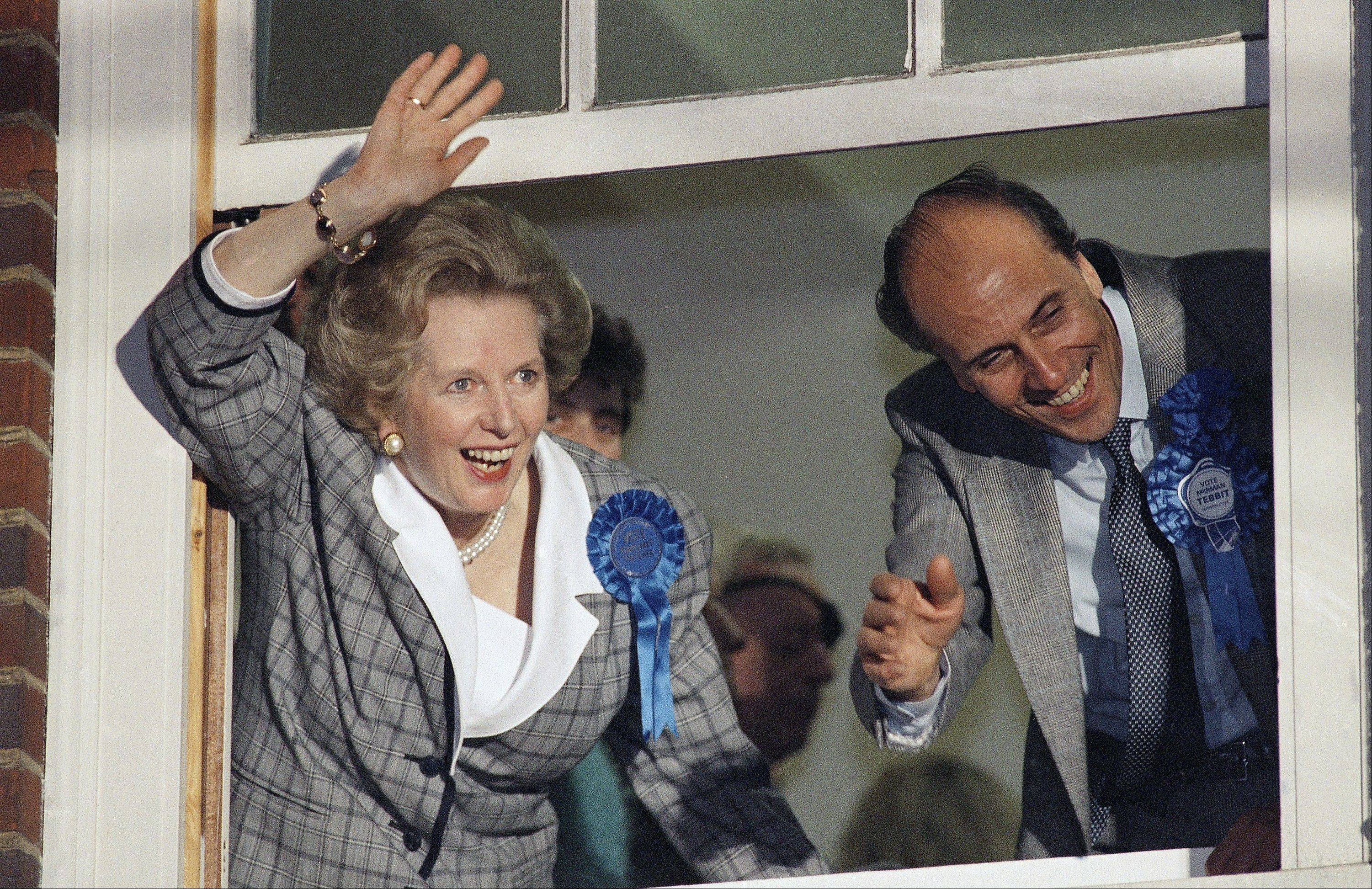 "In this June 12, 1987 file photo, British Prime Minister Margaret Thatcher waves to supporters from Conservative Party headquarters in London after claiming victory in Britain's general election. Ex-spokesman Tim Bell says that Thatcher has died. She was 87. Bell said the woman known to friends and foes as ""the Iron Lady"" passed away Monday morning, April 8, 2013."