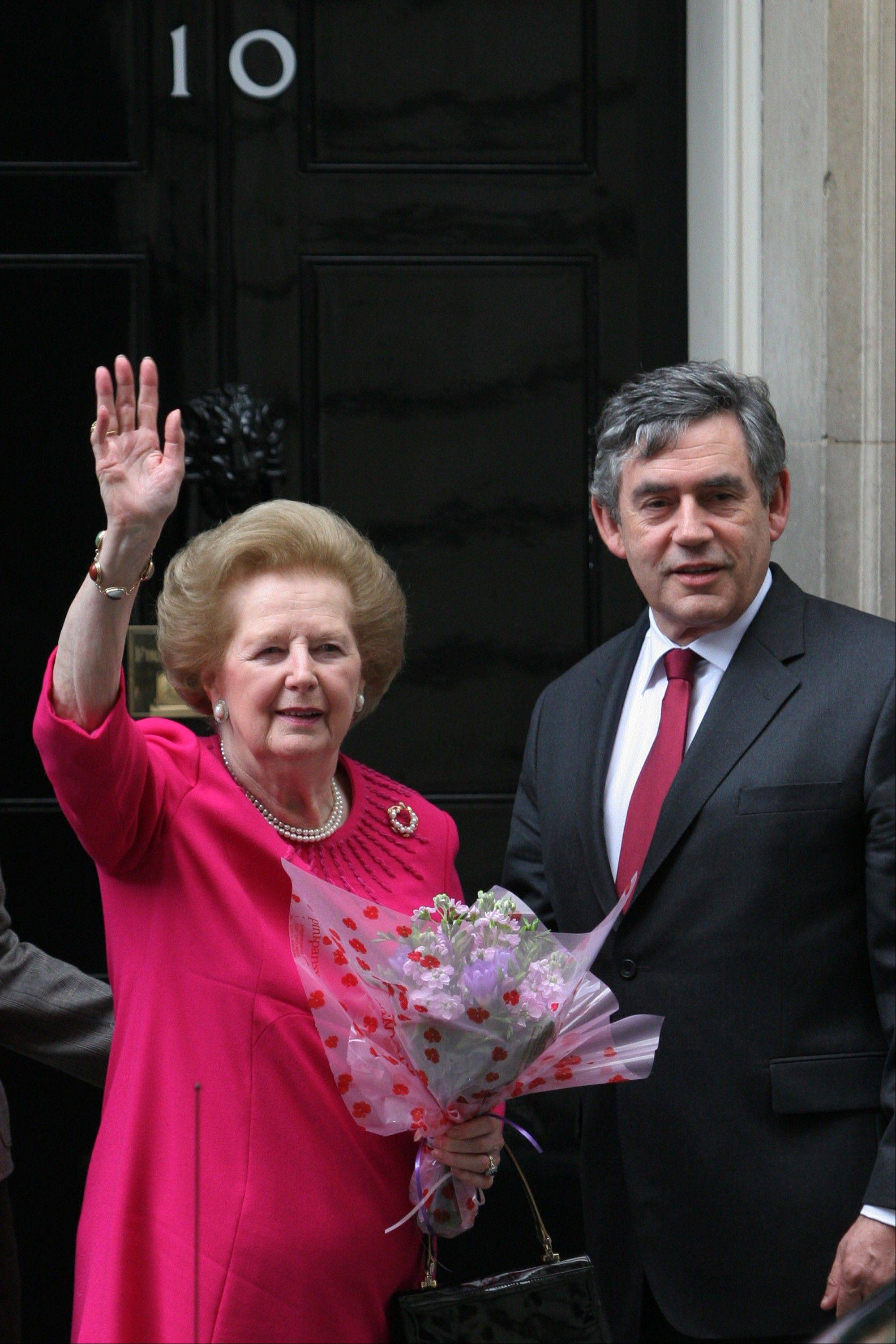 Margaret Thatcher, the former U.K. prime minister, waves as she leaves number 10 Downing Street after a meeting with Gordon Brown, the current U.K. prime minister in London, U.K., on Thursday, Sept. 13, 2007. Thatcher, the former U.K. prime minister who helped end the Cold War and was known as the �Iron Lady� for her uncompromising style, died today. She was 87.