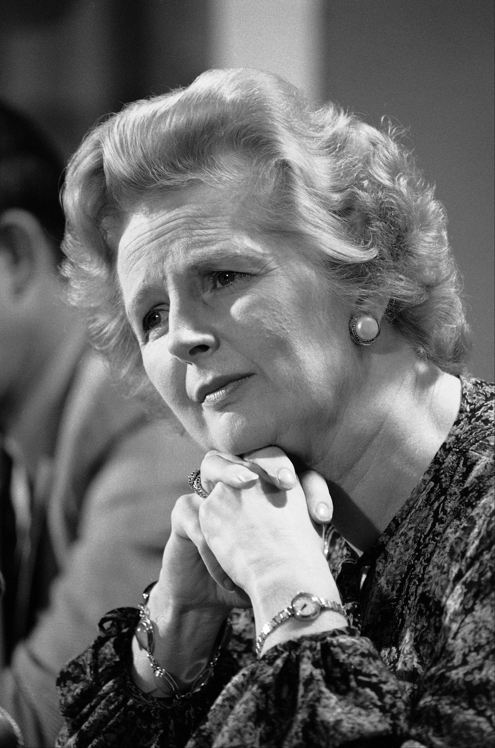 "In this Sept. 14, 1977 file photo, British Conservative Party Leader Margaret Thatcher listens to a reporters question during a news conference at the British Embassy in Washington. Ex-spokesman Tim Bell says that Thatcher has died. She was 87. Bell said the woman known to friends and foes as ""the Iron Lady"" passed away Monday morning, April 8, 2013."