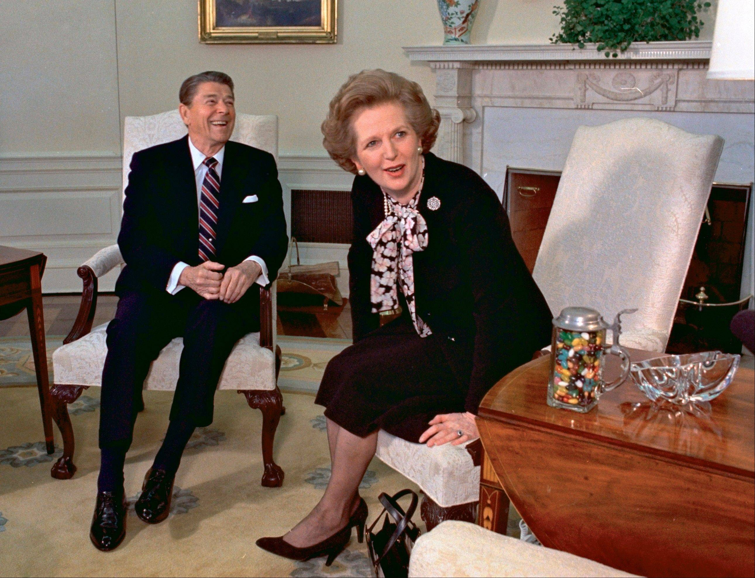 In this Feb. 20, 1985 file photo, former British Prime Minister Margaret Thatcher meets with her friend and political ally President Ronald Reagan during a visit to the White House in Washington. Thatcher, who led Britain for 11 years, died of a stroke Monday morning, April 8, 2013.