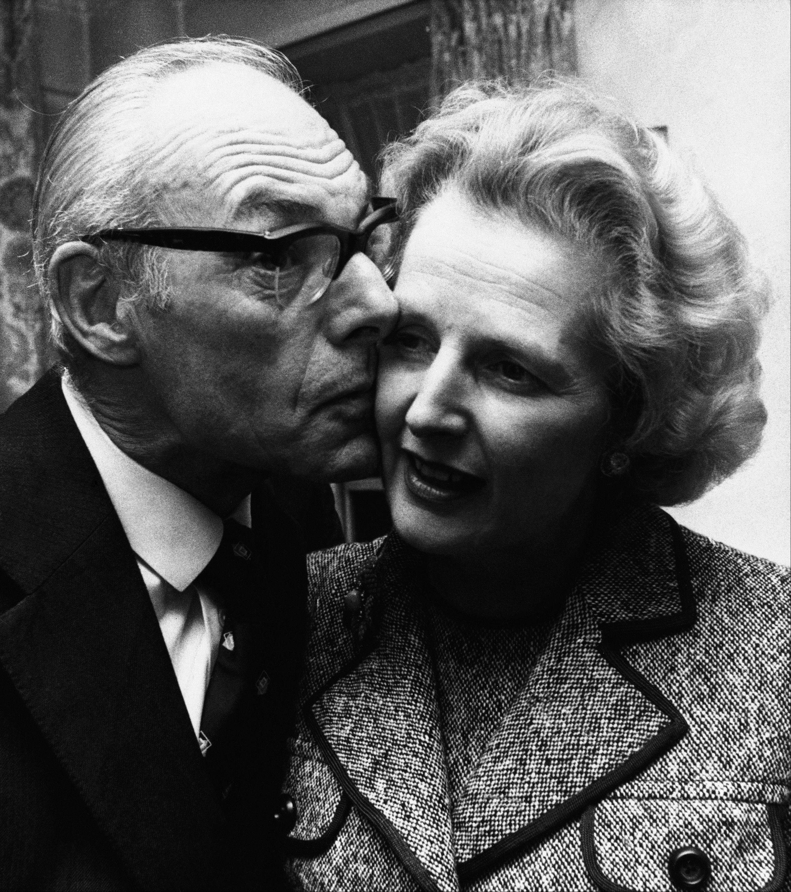 In a Feb. 4, 1975 file photo, Margaret Thatcher gets a kiss from her husband Denis in London, Feb. 4, 1975, after she had come out on top with 130 votes in the first round of the election for the Conservative party leadership. Thatchers former spokesman, Tim Bell, said that the former British Prime Minister Margaret Thatcher had died Monday morning, April 8, 2013, of a stroke. She was 87 years old.