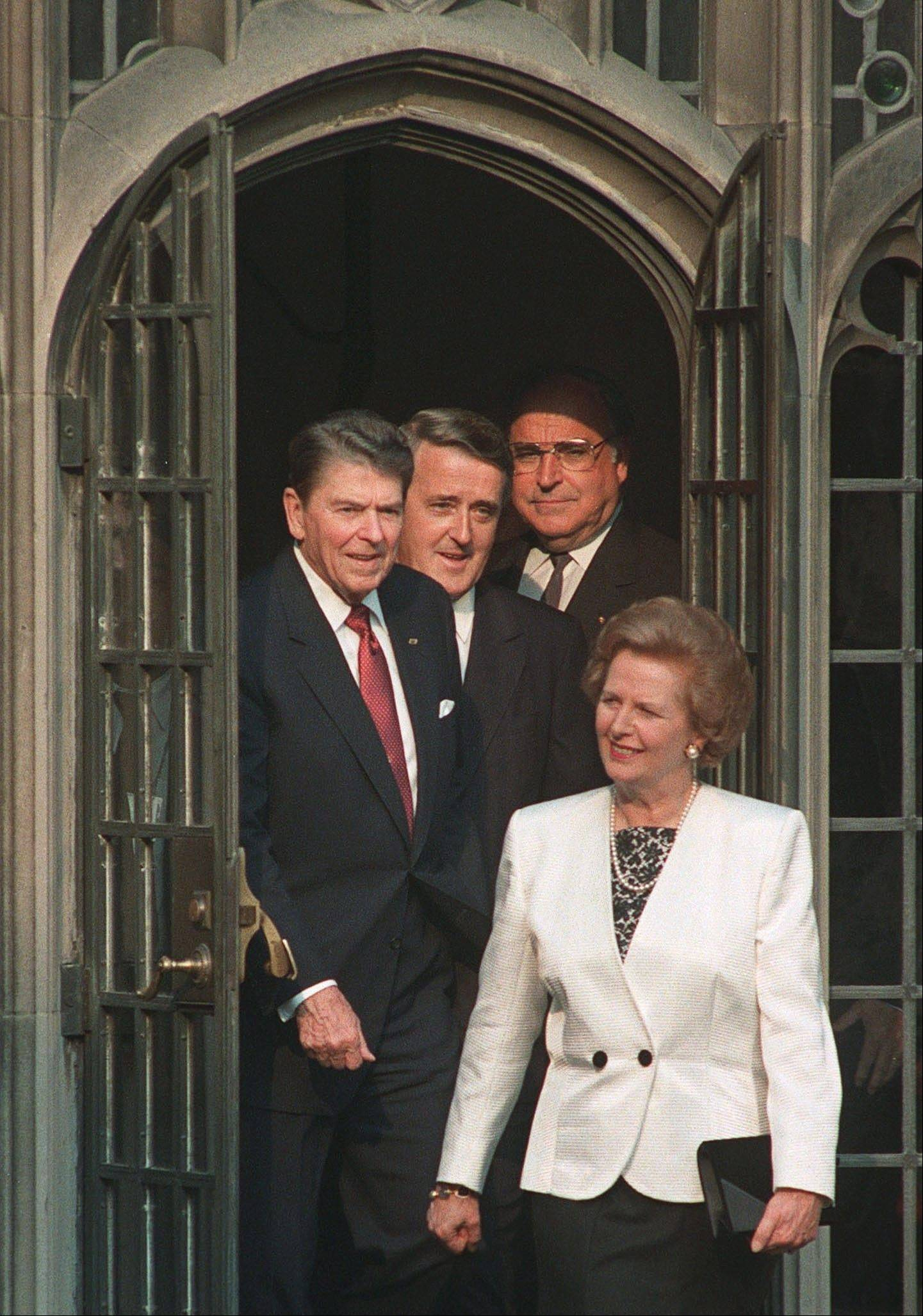 In a June 20, 1988 photo, Economic Summit leaders, from left, President Ronald Reagan, Canadian Prime Minister Brian Mulroney and West German Chancellor Helmut Kohl follow British Prime Minister Margaret Thatcher into a courtyard at Hart House in Toronto. Thatchers former spokesman, Tim Bell, said that the former British Prime Minister Margaret Thatcher had died Monday, April 8, 2013, of a stroke. She was 87.