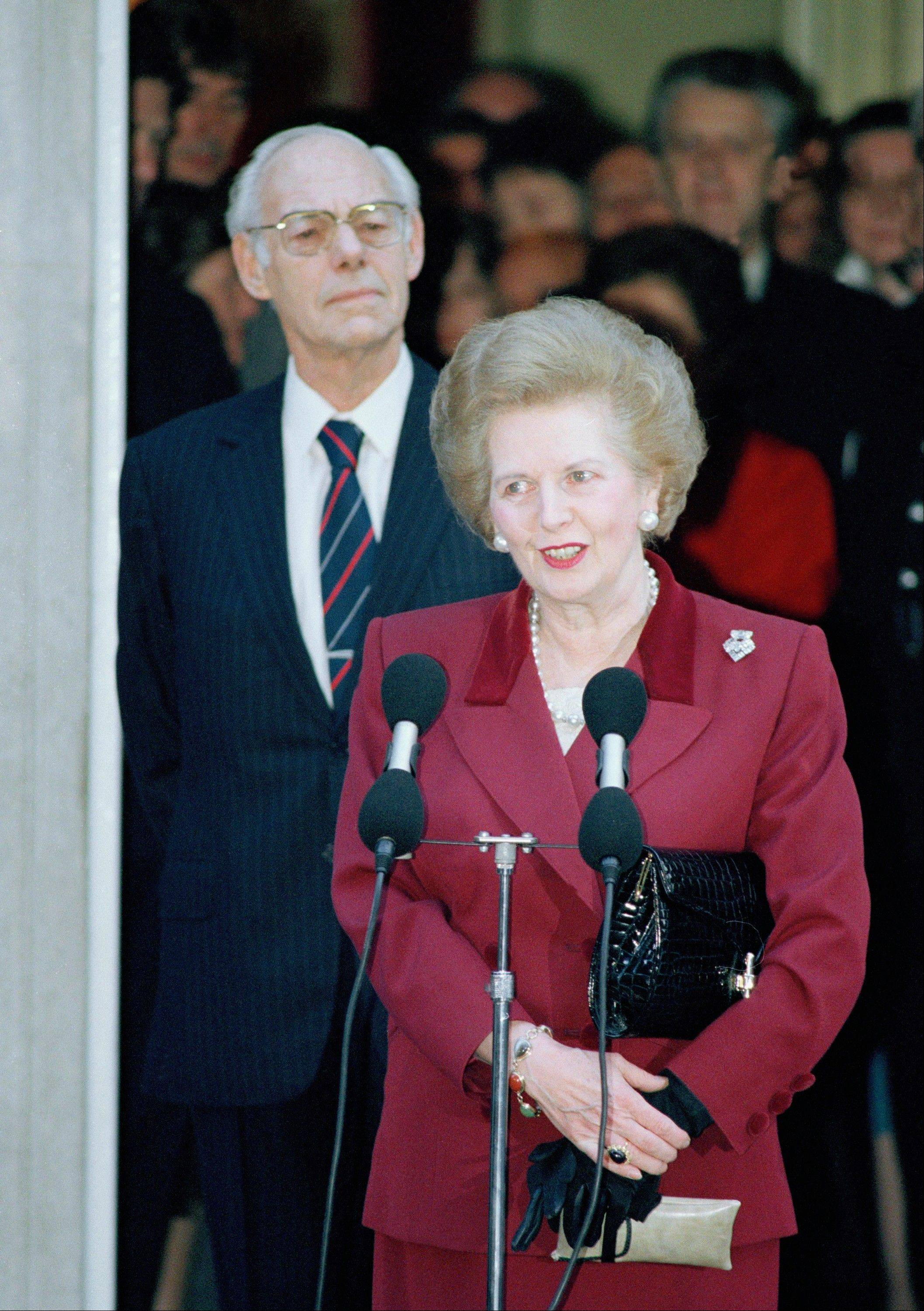 Margaret Thatcher makes a statement to reporters as Denis Thatcher listens, as she leaves No. 10 Downing Street, Westminster in a Wednesday, Nov. 28, 1990 file photo, for Buckingham Palace where she will resign as Prime Minister to Queen Elizabeth II. Thatchers former spokesman, Tim Bell, said that the former British Prime Minister Margaret Thatcher had died Monday morning, April 8, 2013, of a stroke. She was 87.