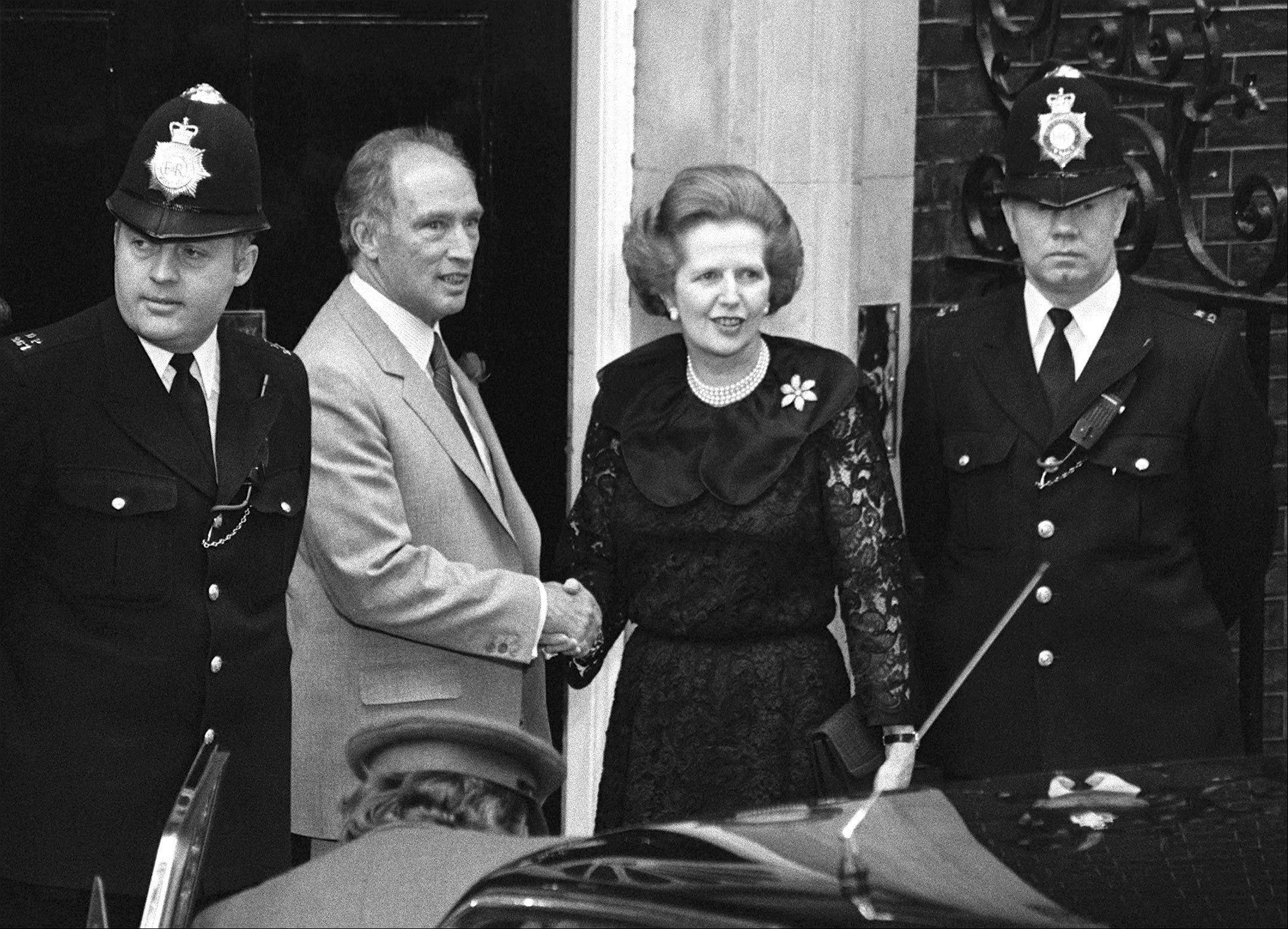 Canadian Prime Minister Pierre Trudeau is greeted by Britain's Prime Minister Margaret Thatcher outside 10 Downing Street, London, on June 7, 1984. Thatchers former spokesman, Tim Bell, said that the former British Prime Minister Margaret Thatcher died Monday, April 8, 2013, of a stroke. She was 87.