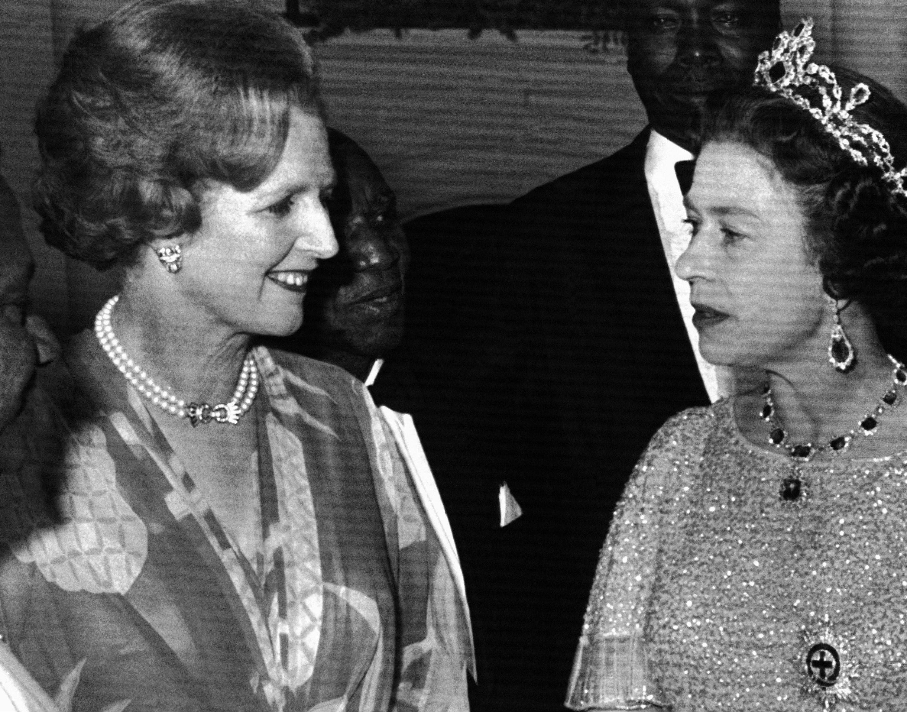This is an Aug. 1, 1979 file photo of Britain's Queen Elizabeth II talks with British Prime Minister, Margaret Thatcher, left, at a reception for the 39 heads of delegations attending the Commonwealth Conference in Lusaka, Zambia. Former British Prime Minister Margaret Thatcher, whose conservative ideas made an enduring impact on Britain, died Monday April 8, 2013. She was 87.