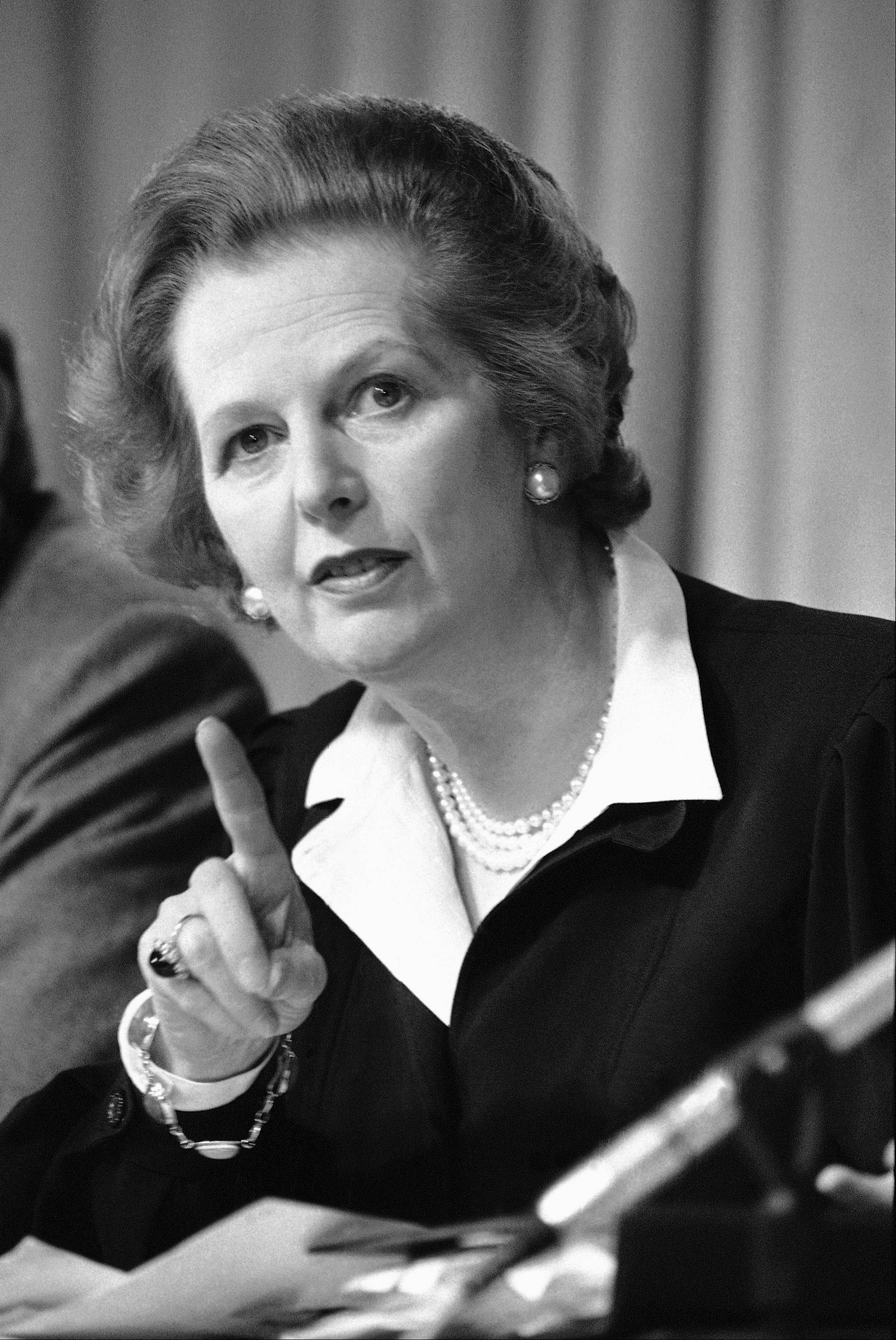 "In this May 31, 1983 file photo, Britain's Prime Minister Margaret Thatcher raises her finger as she makes a point during a Conservative Party news conference in London. Ex-spokesman Tim Bell says that Thatcher has died. She was 87. Bell said the woman known to friends and foes as ""the Iron Lady"" passed away Monday morning, April 8, 2013."