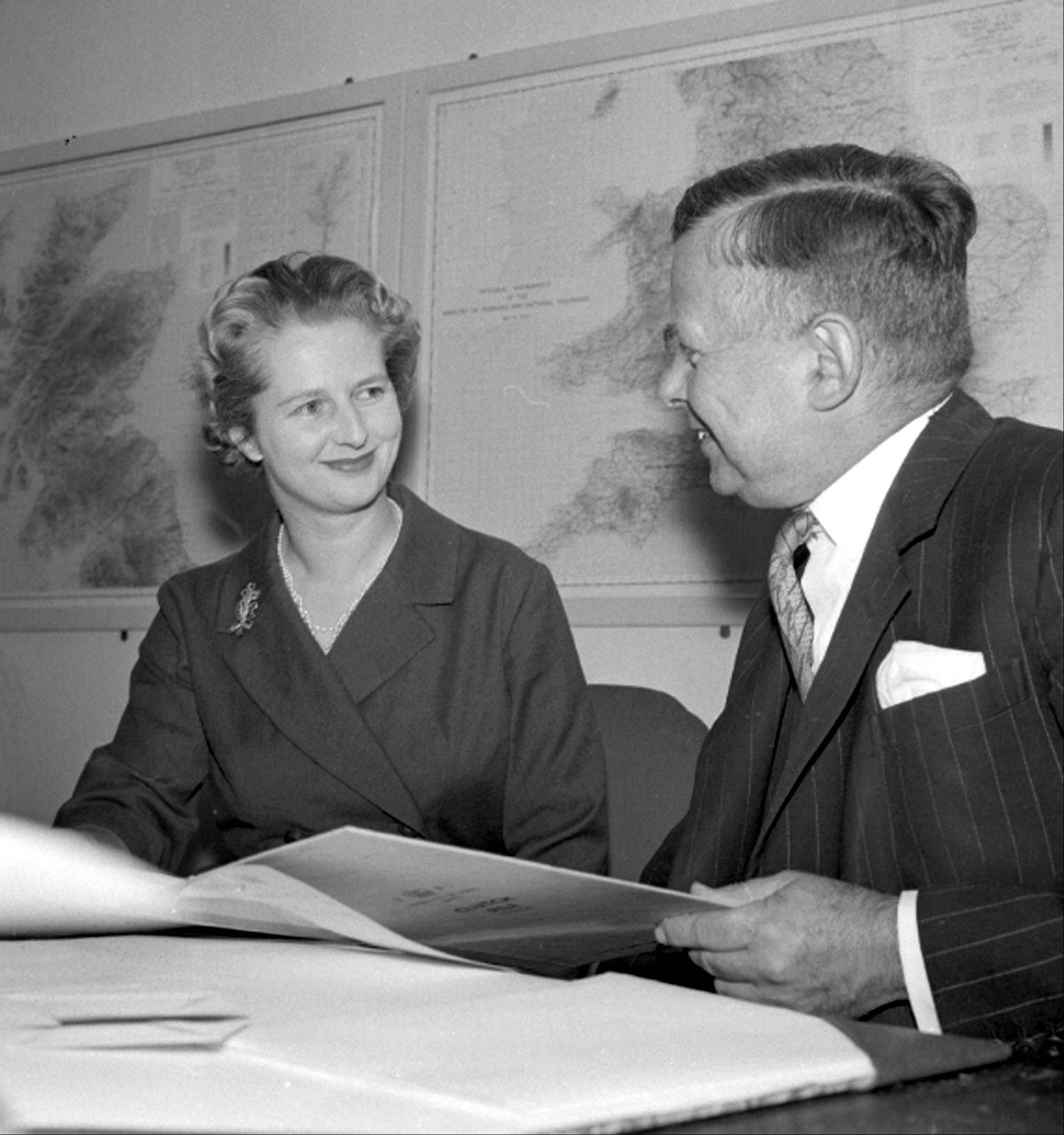In an Oct. 12, 1961 file photo, Mrs. Margaret Thatcher, the newly-appointed Joint Parliamentary Secretary at the Ministry of Pensions and national Insurance, talks with the Minister John Boyd Carpenter, as she begins her new job at the Ministry, in London. Thatchers former spokesman, Tim Bell, said that the former British Prime Minister Margaret Thatcher had died Monday morning, April 8, 2013, of a stroke. She was 87.