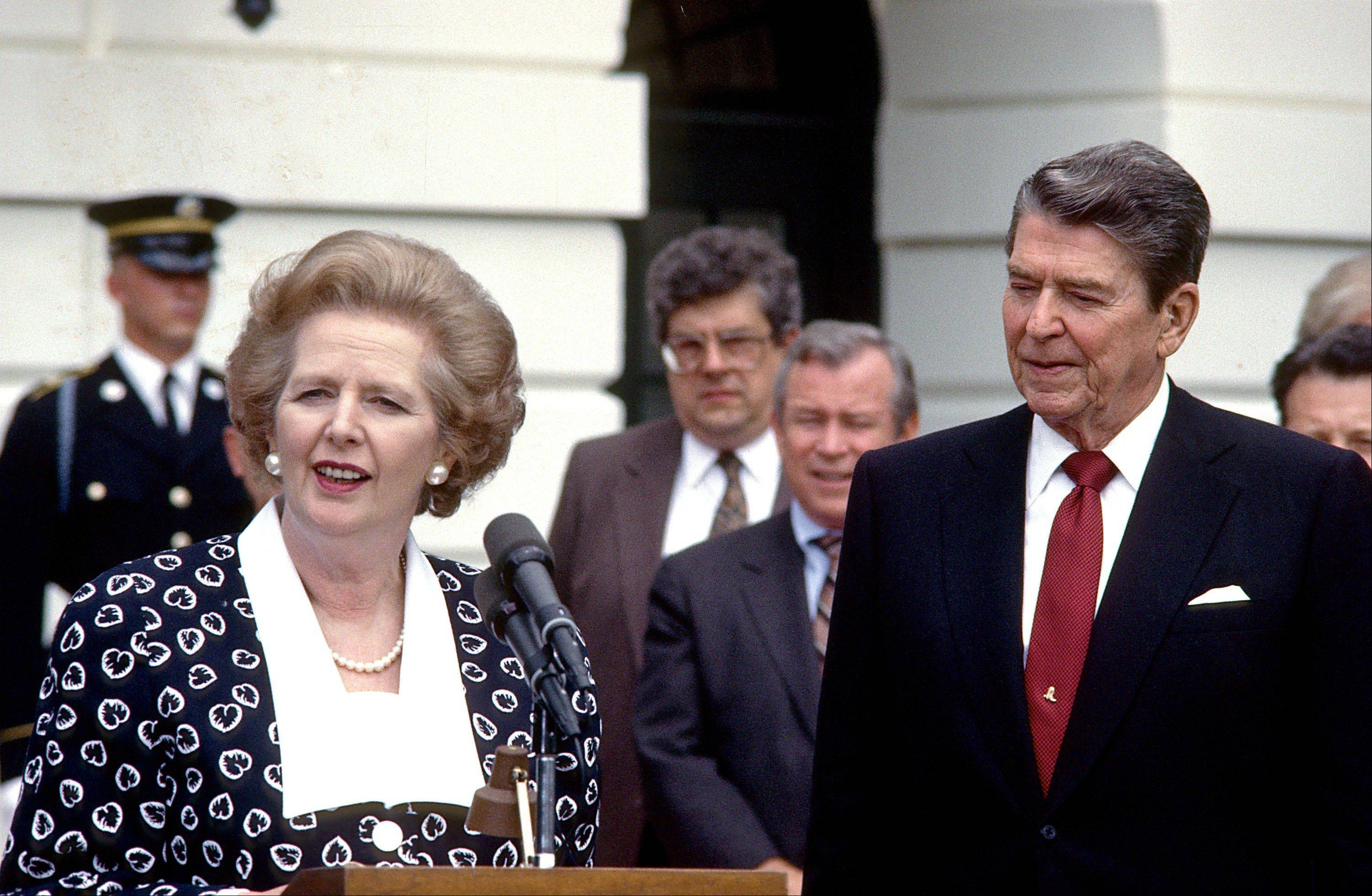 In a Friday, July 17, 1987 file photo, Prime Minister Margaret Thatcher of the United Kingdom, left, makes remarks after visiting United States President Ronald Reagan, right, at the White House in Washington, D.C. Thatchers former spokesman, Tim Bell, said that the former British Prime Minister Margaret Thatcher died Monday morning, April 8, 2013, of a stroke. She was 87.