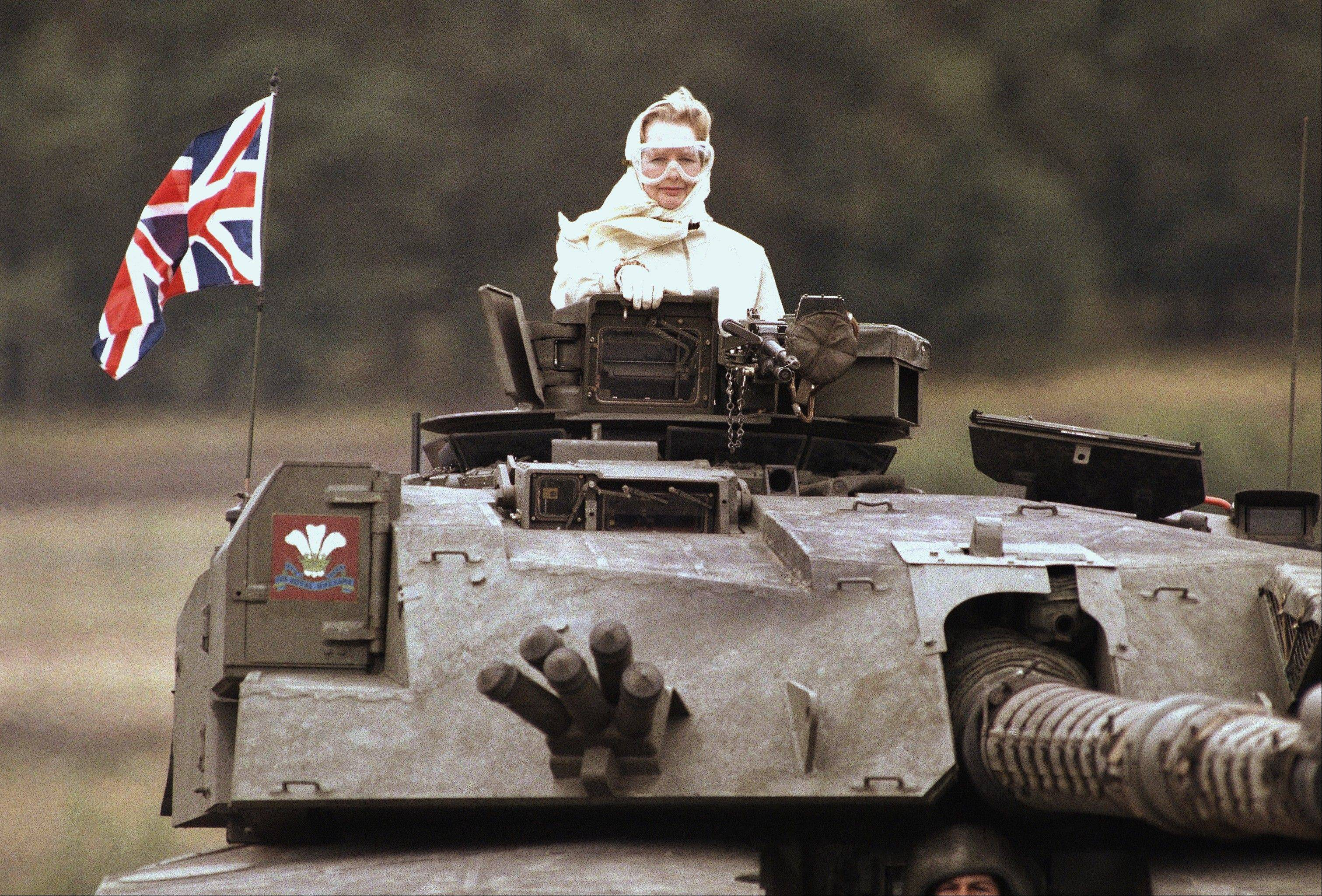British Prime Minister Margaret Thatcher stands in a British tank during a visit to British forces in Fallingbostel, some 120 km (70 miles) south of Hamburg, Germany. on Sept. 17, 1986. Thatchers former spokesman, Tim Bell, said that the former British Prime Minister Margaret Thatcher had died Monday morning, April 8, 2013, of a stroke. She was 87.