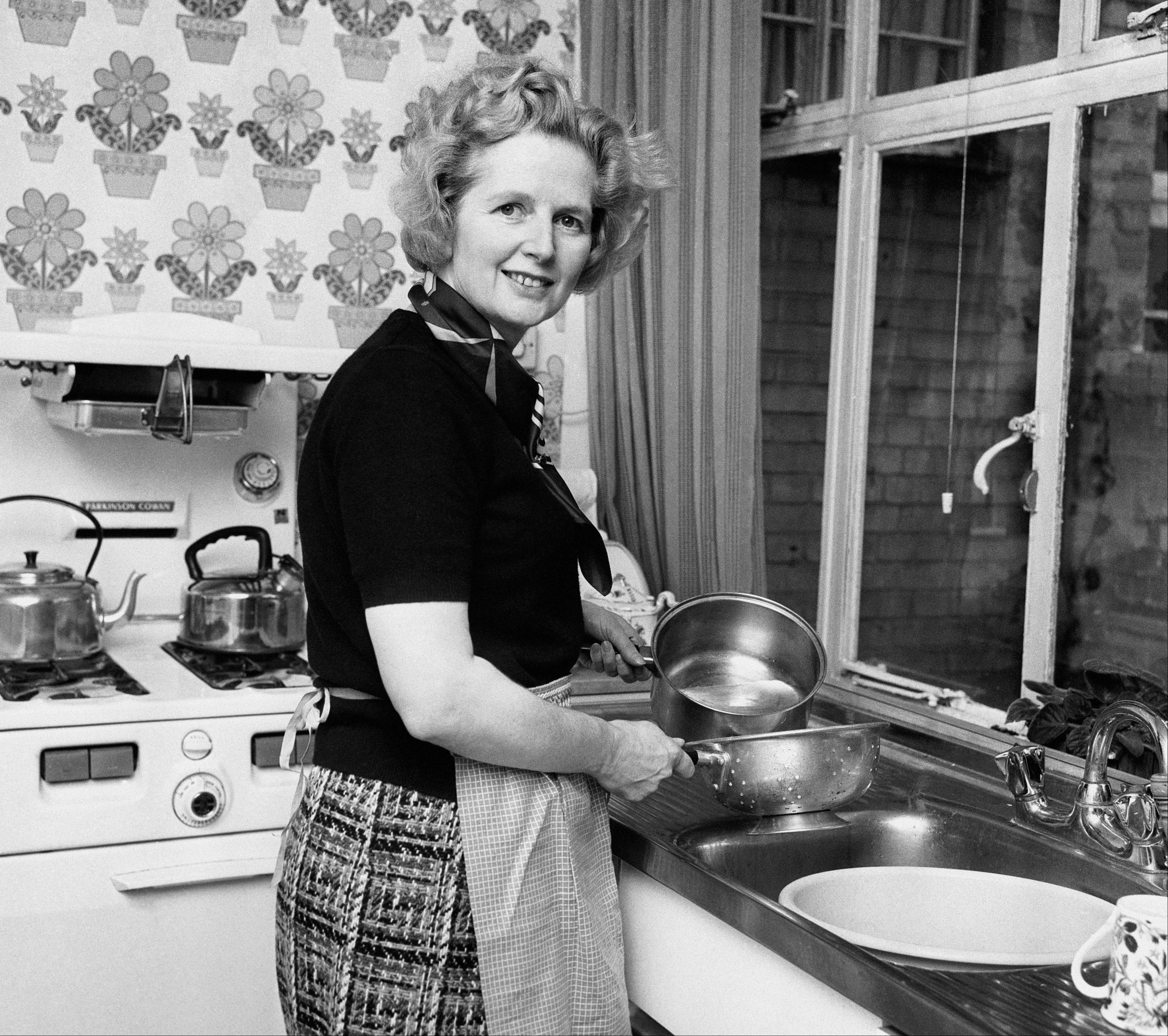 This is a Feb, 1, 1975 file photo of the them Conservative Member of Parliament Margaret Thatcher, in her Chelsea home kitchen. Former British Prime Minister Margaret Thatcher, whose conservative ideas made an enduring impact on Britain died Monday April 8, 2013. She was 87.