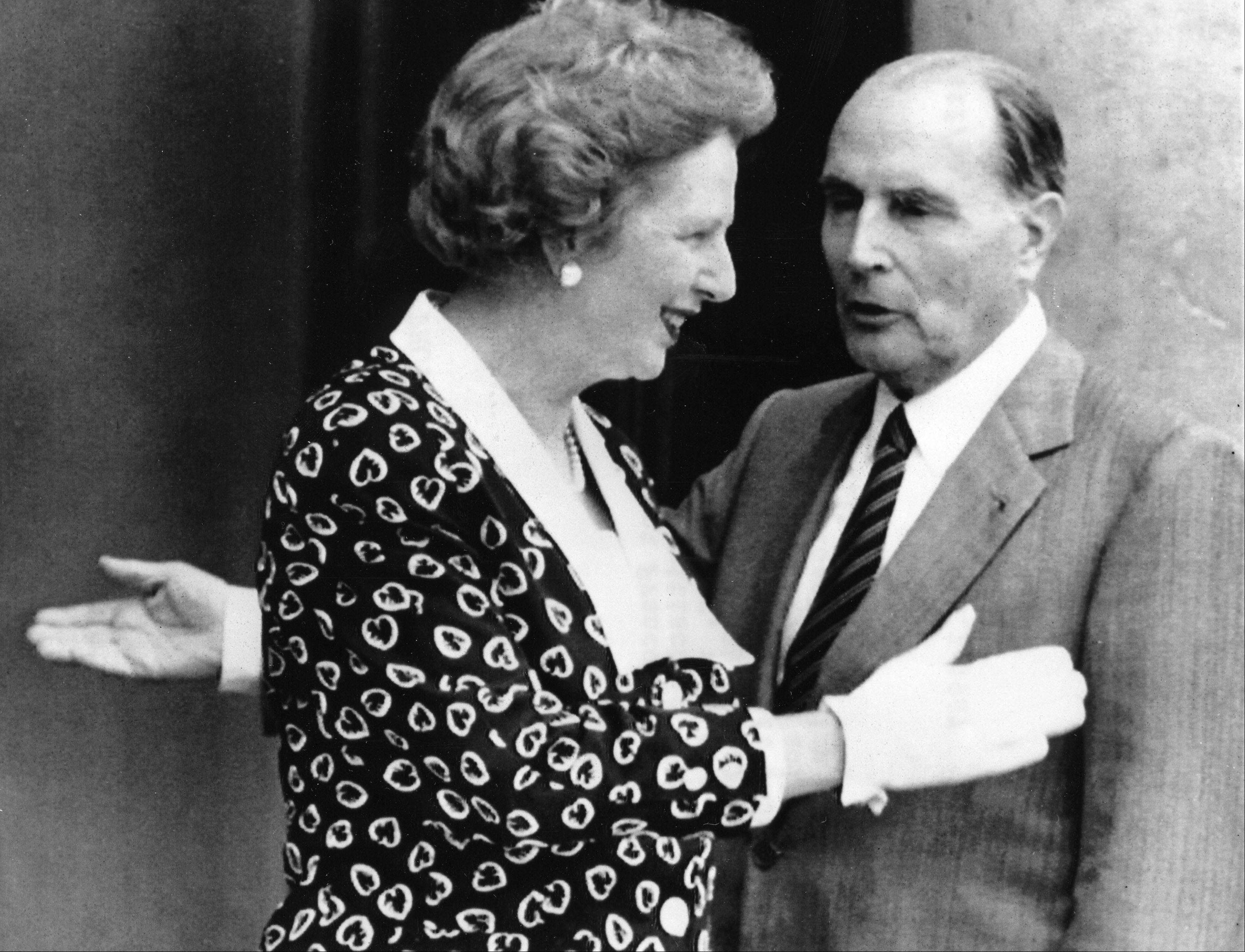 This is a July 29, 1987 file photo of French President Francois Mitterrand and his guest British Prime Minister Margaret Thatcher aa they gesture in front of the Elysee Palace in Paris, France. Margaret Thatcher�s former spokesman, Tim Bell, said that the former prime minister had died Monday April 8, 2013 of a stroke. She was 87.