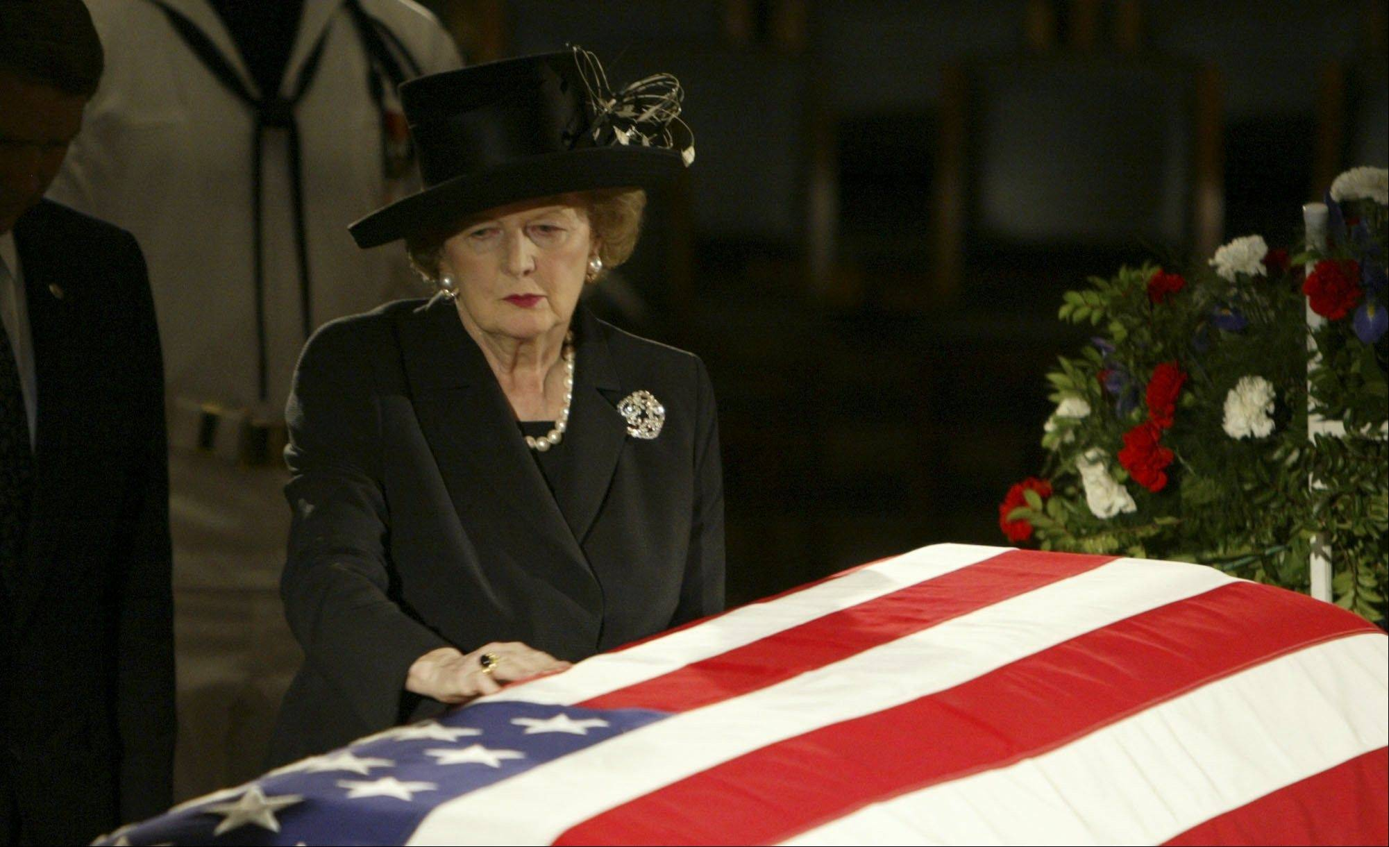 In this June 9, 2004 file photo, former British Prime Minister Margaret Thatcher pauses at the casket of former U.S. President Ronald Reagan where he was lying in state in the Capitol Rotunda on Capitol Hill in Washington. Thatchers former spokesman, Tim Bell, said that the former British Prime Minister Margaret Thatcher died Monday morning, April 8, 2013, of a stroke. She was 87.