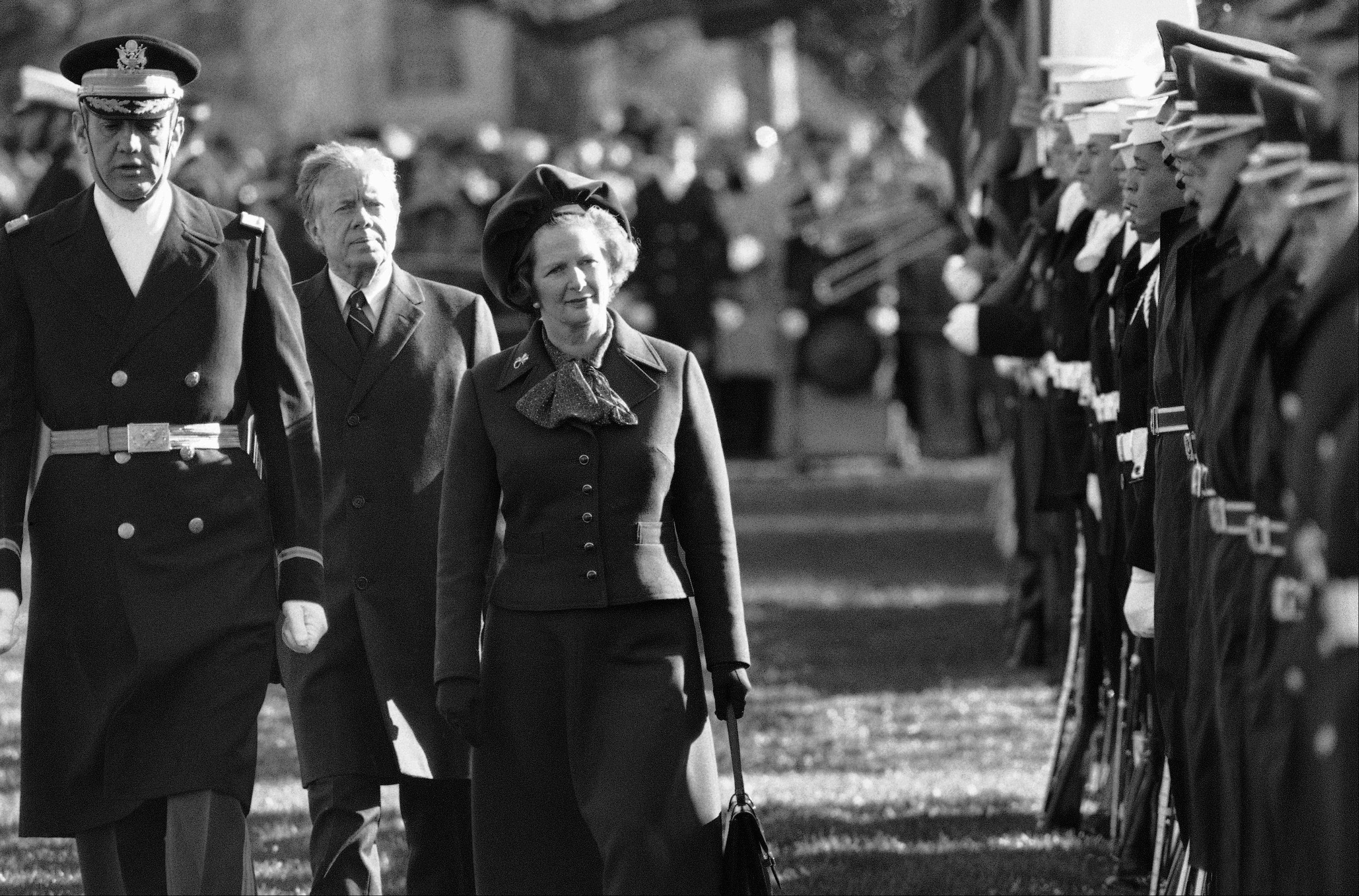 "In this Dec. 17, 1979 file photo, British Prime Minister Margaret Thatcher reviews the honor guard at the White House in Washington, as President Jimmy Carter follows. At left in Col. Stanley Bonta, commander of the guard. Ex-spokesman Tim Bell says that Thatcher has died. She was 87. Bell said the woman known to friends and foes as ""the Iron Lady"" passed away Monday morning, April 8, 2013."
