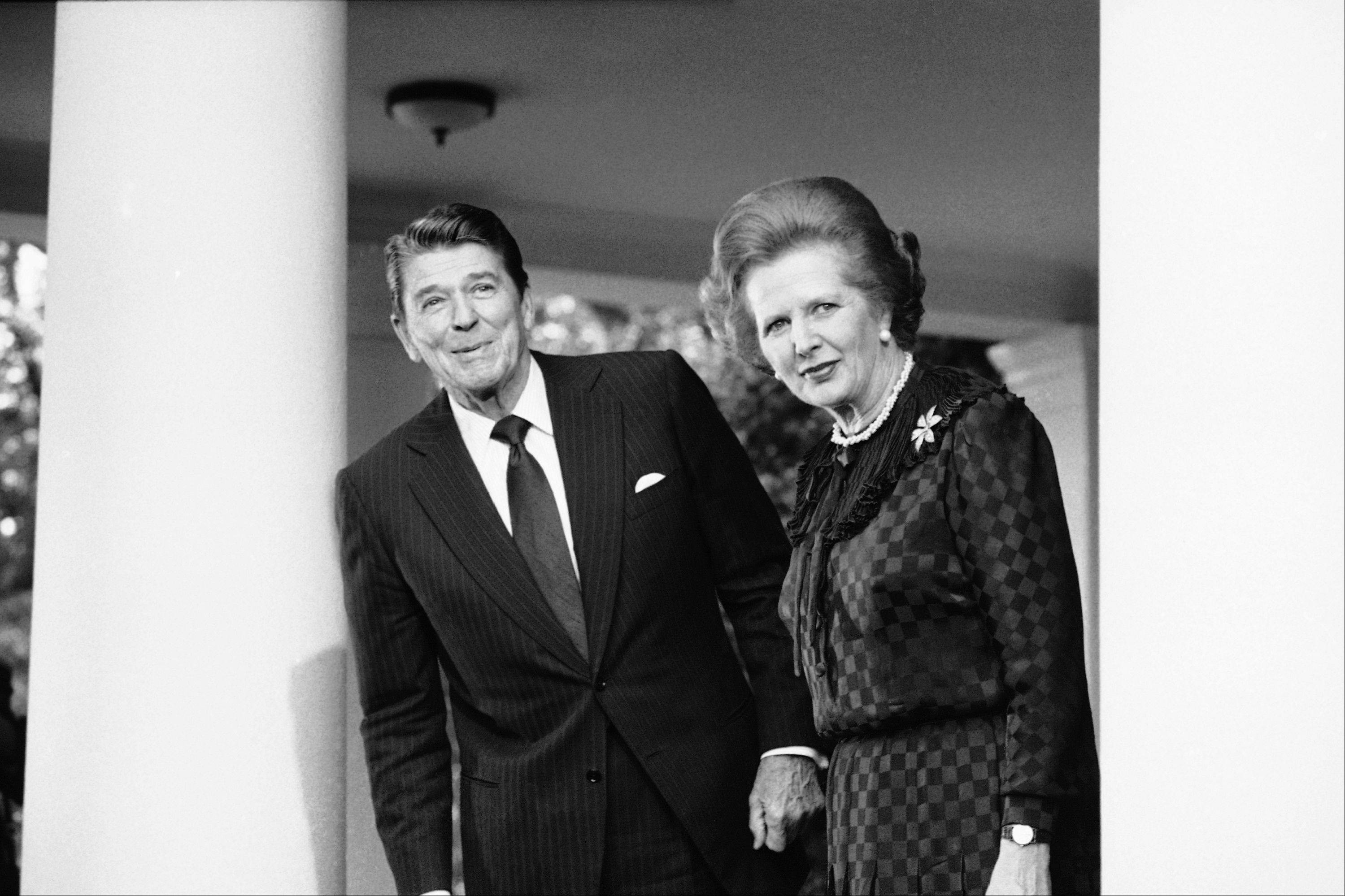 "In this June 23, 1982 file photo, President Ronald Reagan and British Prime Minister Margaret Thatcher speak to reporters at the White House in Washington. Ex-spokesman Tim Bell says that Thatcher has died. She was 87. Bell said the woman known to friends and foes as ""the Iron Lady"" passed away Monday morning, April 8, 2013."