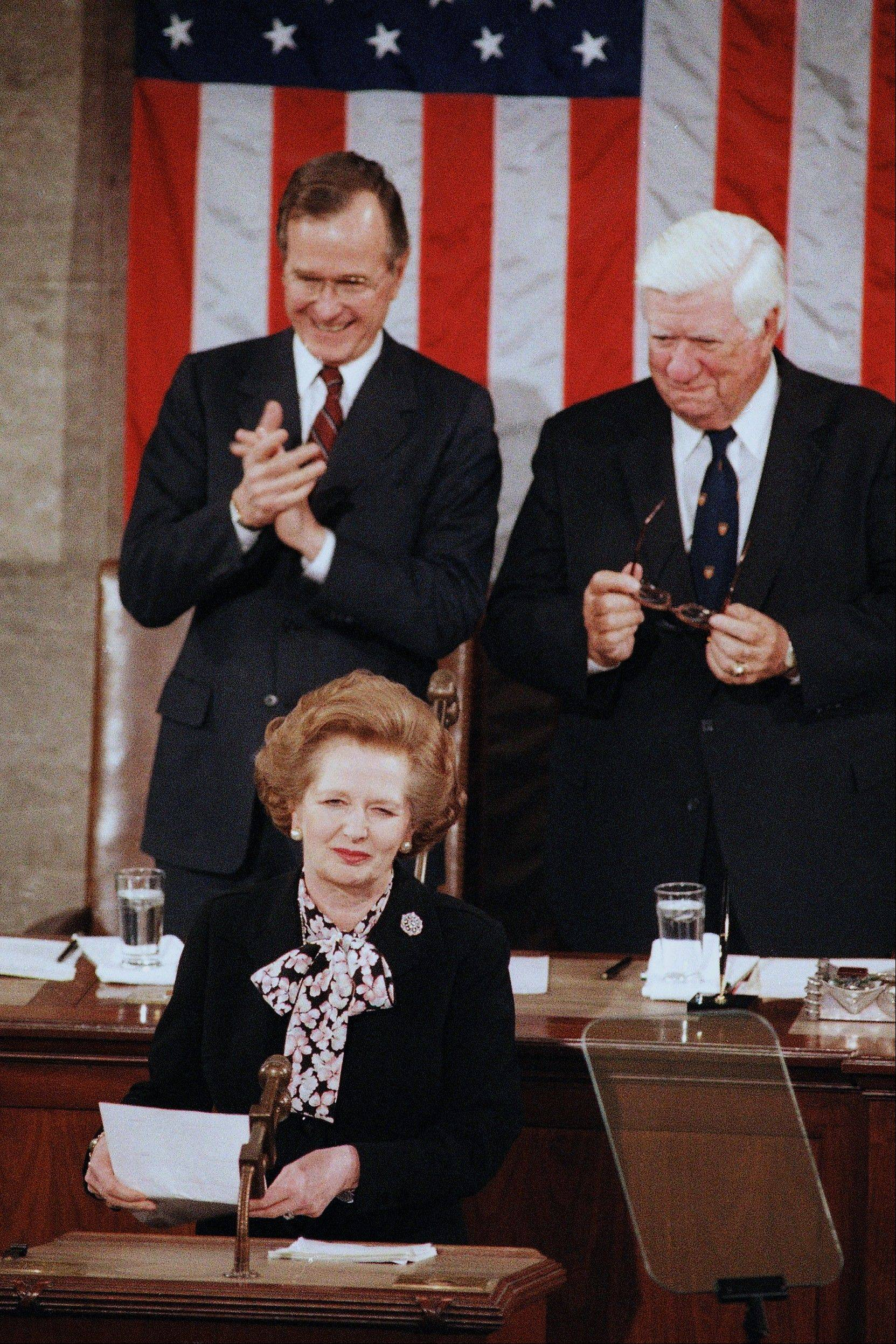 In a Feb. 20, 1985 file photo, British Prime Minister Margaret Thatcher is applauded by Vice President George Bush, left, as House Speaker Thomas P. O'Neill, Jr. looks on just before she addressed a joint meeting of the U.S. Congress, in Washington. Thatchers former spokesman, Tim Bell, said that the former British Prime Minister Margaret Thatcher had died Monday morning, April 8, 2013, of a stroke. She was 87.