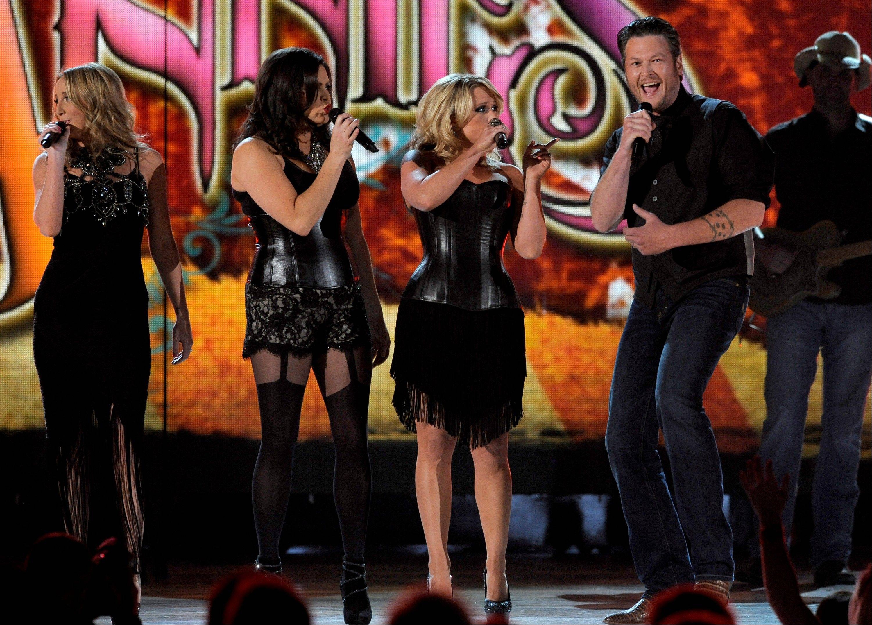 From left, Ashley Monroe, Angaleena Presley and Miranda Lambert of musical group Pistol Annies, and singer Blake Shelton perform at the 48th Annual Academy of Country Music Awards at the MGM Grand Garden Arena in Las Vegas on Sunday, April 7, 2013.