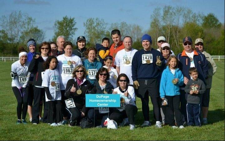 Supporters of the DuPage Homeownership Center took part in the inaugural Human Race, including Executive Director Debra Olson, kneeling from left, and board members Joan Rickard and Linda Shea.