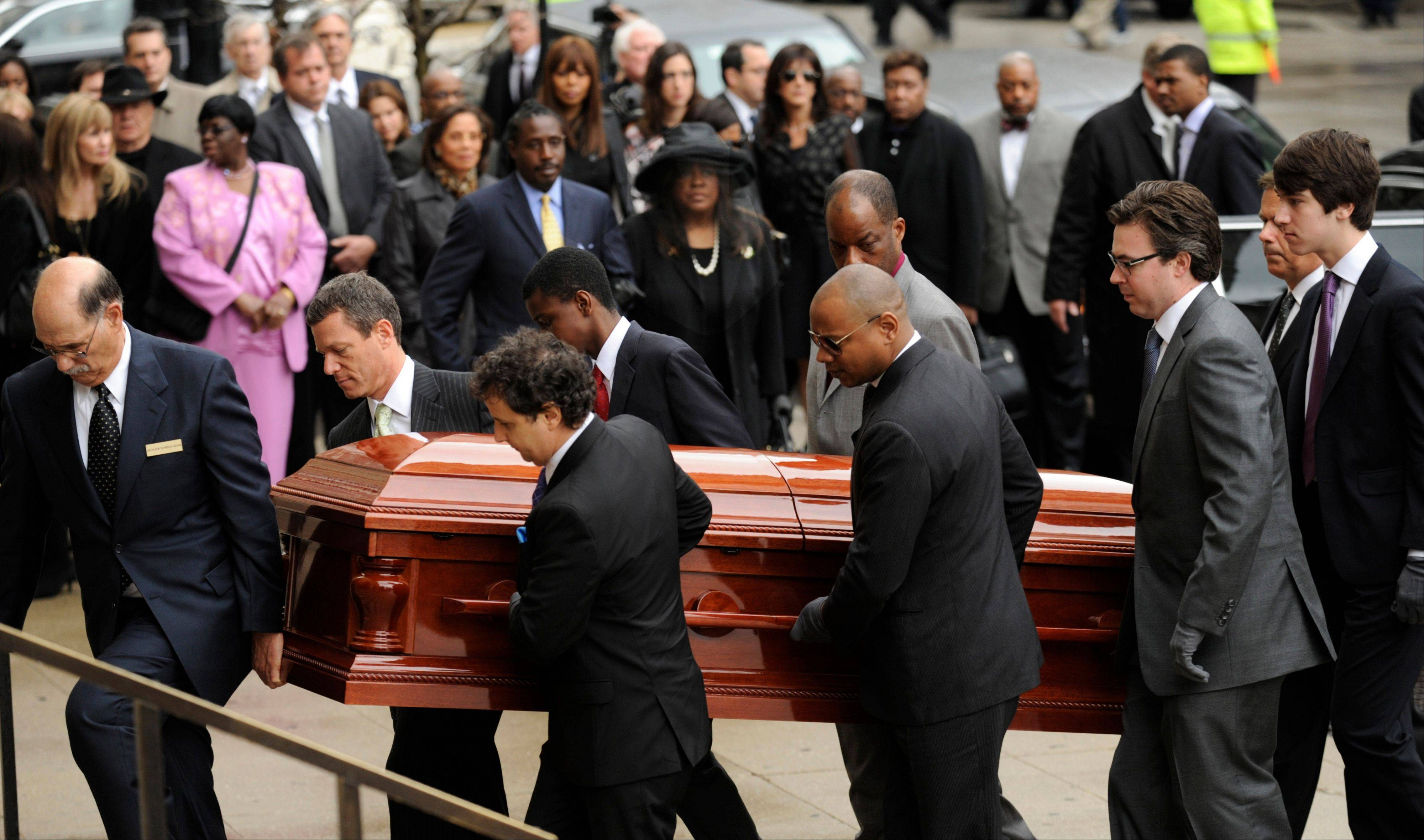 Pallbearers carry the casket of film critic Roger Ebert before his funeral at Holy Name Cathedral in Chicago, Monday.
