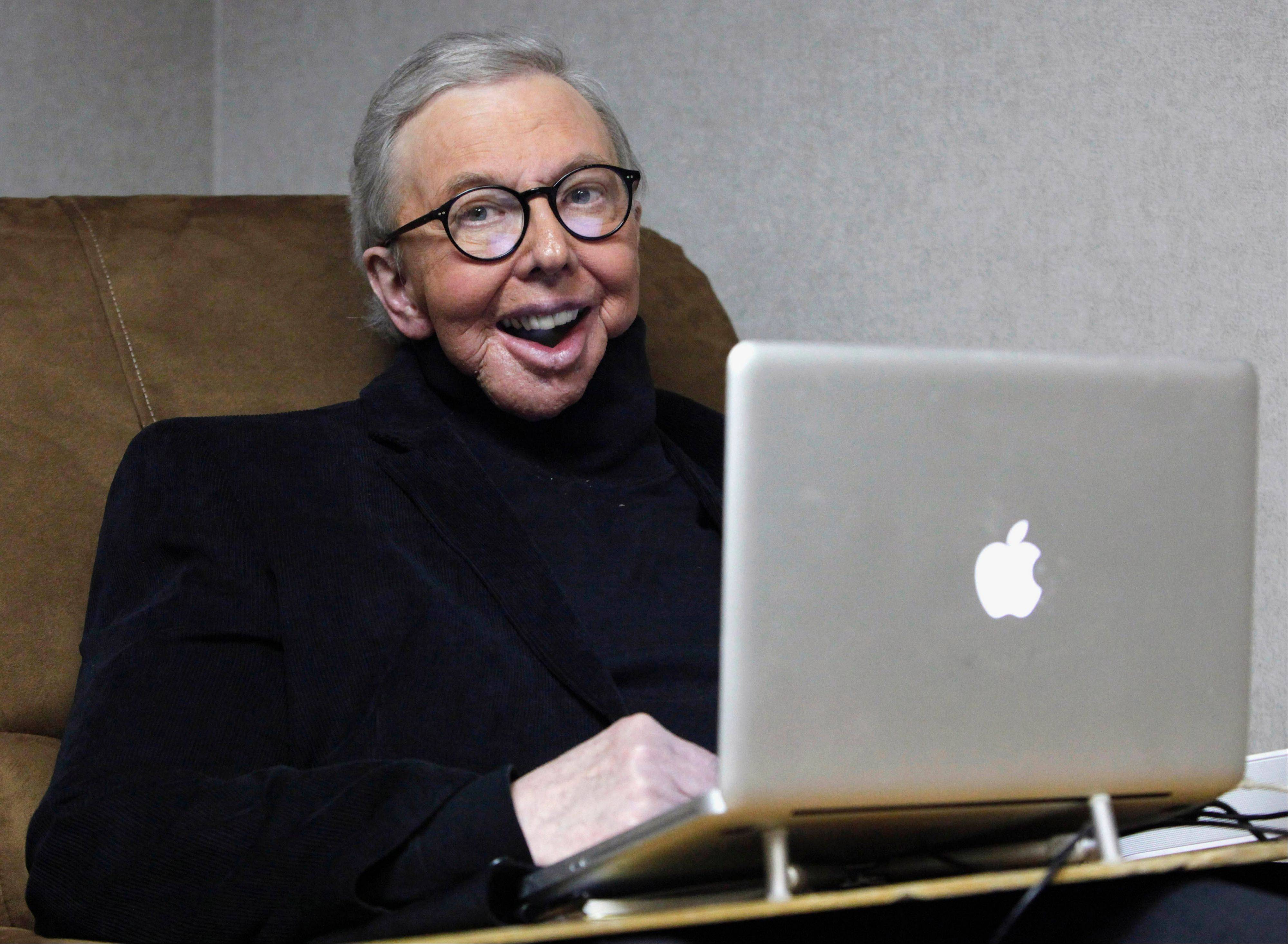 Pulitzer Prize-winning movie critic Roger Ebert works in his office at the WTTW-TV studios in Chicago in 2011.