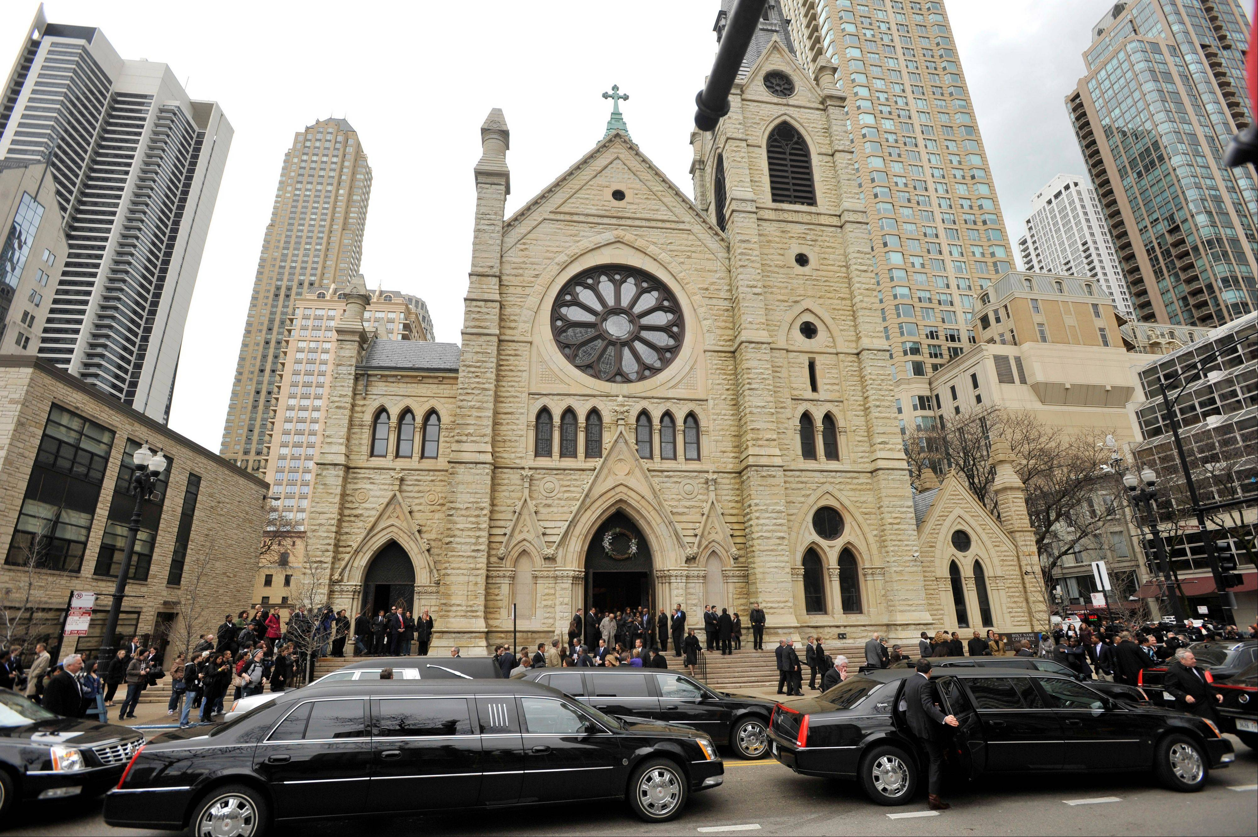 Mourners leave Holy Name Cathedral after film critic Roger Ebert's funeral in Chicago, April 8, 2013. The Pulitzer Prize winning movie reviewer died Thursday, April 4 at age 70 after a long battle with cancer.