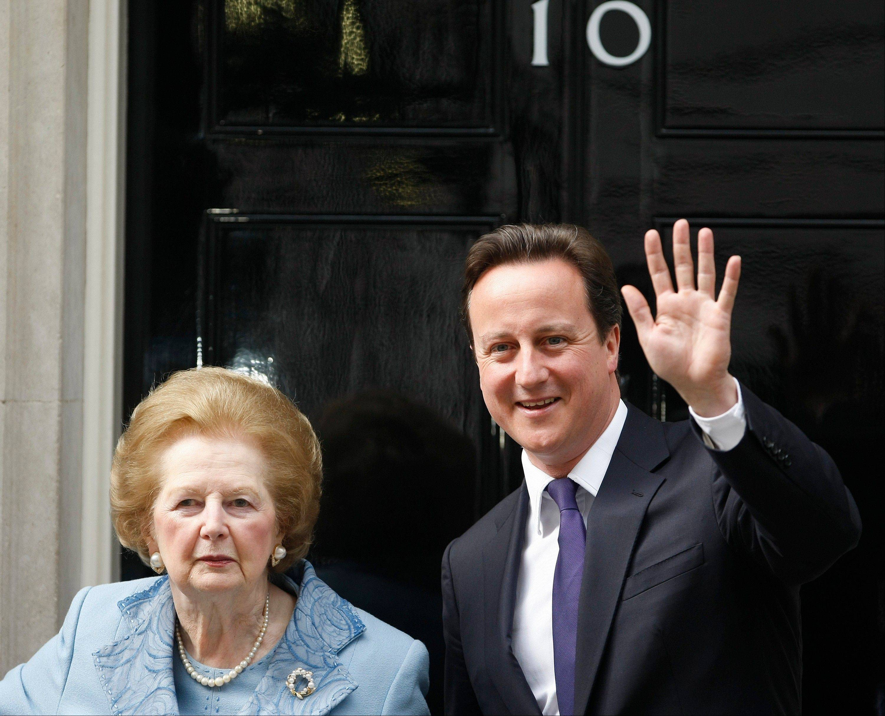 This is a Tuesday, June, 8, 2010 file photo of Britian's Prime Minister David Cameron with former Prime Minister Margaret Thatcher on the doorstep of 10 Downing Street in London.