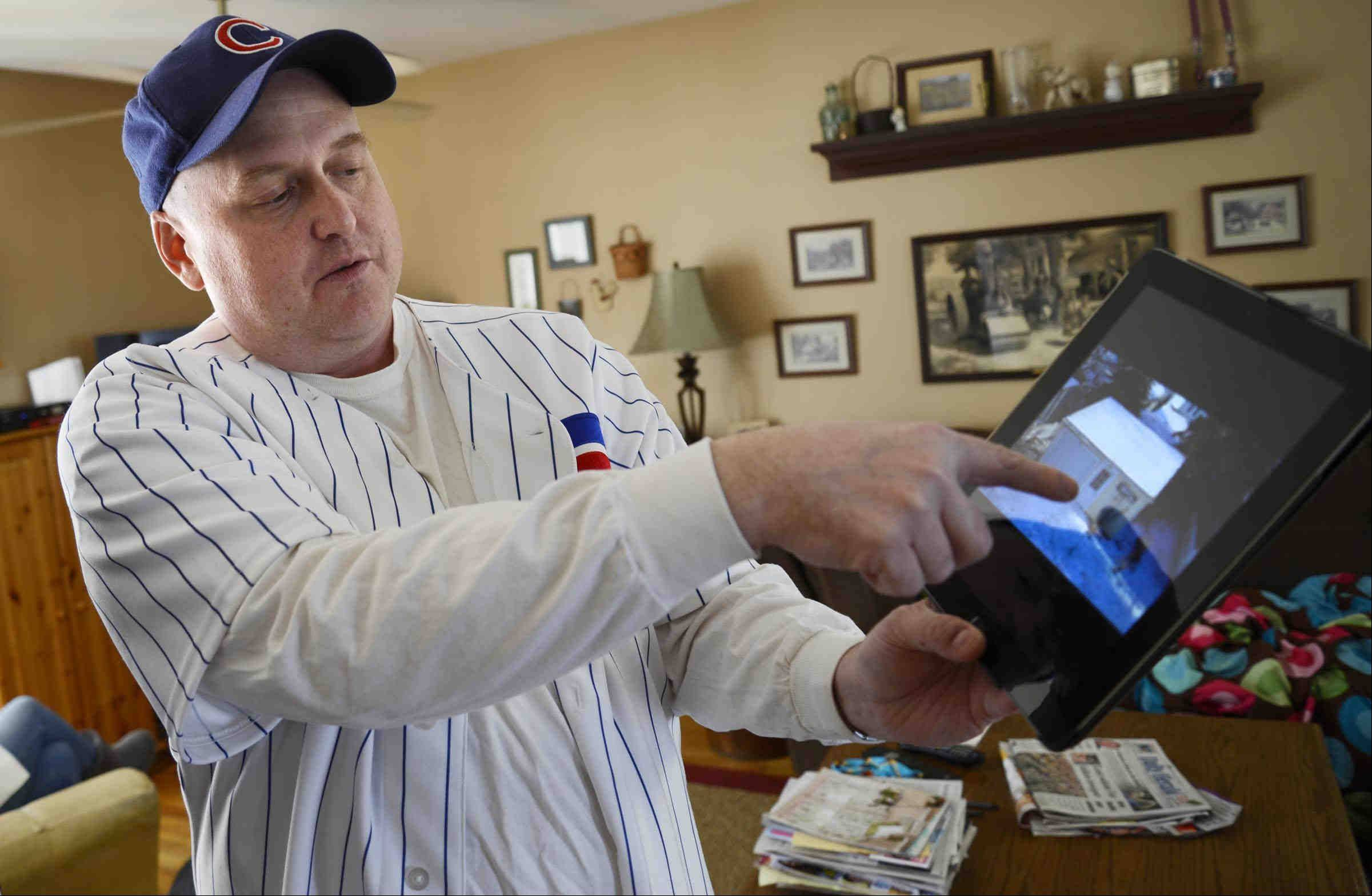 Pointing to a photo of the barrier island community of Stone Harbor in New Jersey, Charley McLenna shows where he lost his Cubs hat. The Lake in the Hills man recently reclaimed his hat, which somehow survived Hurricane Sandy.